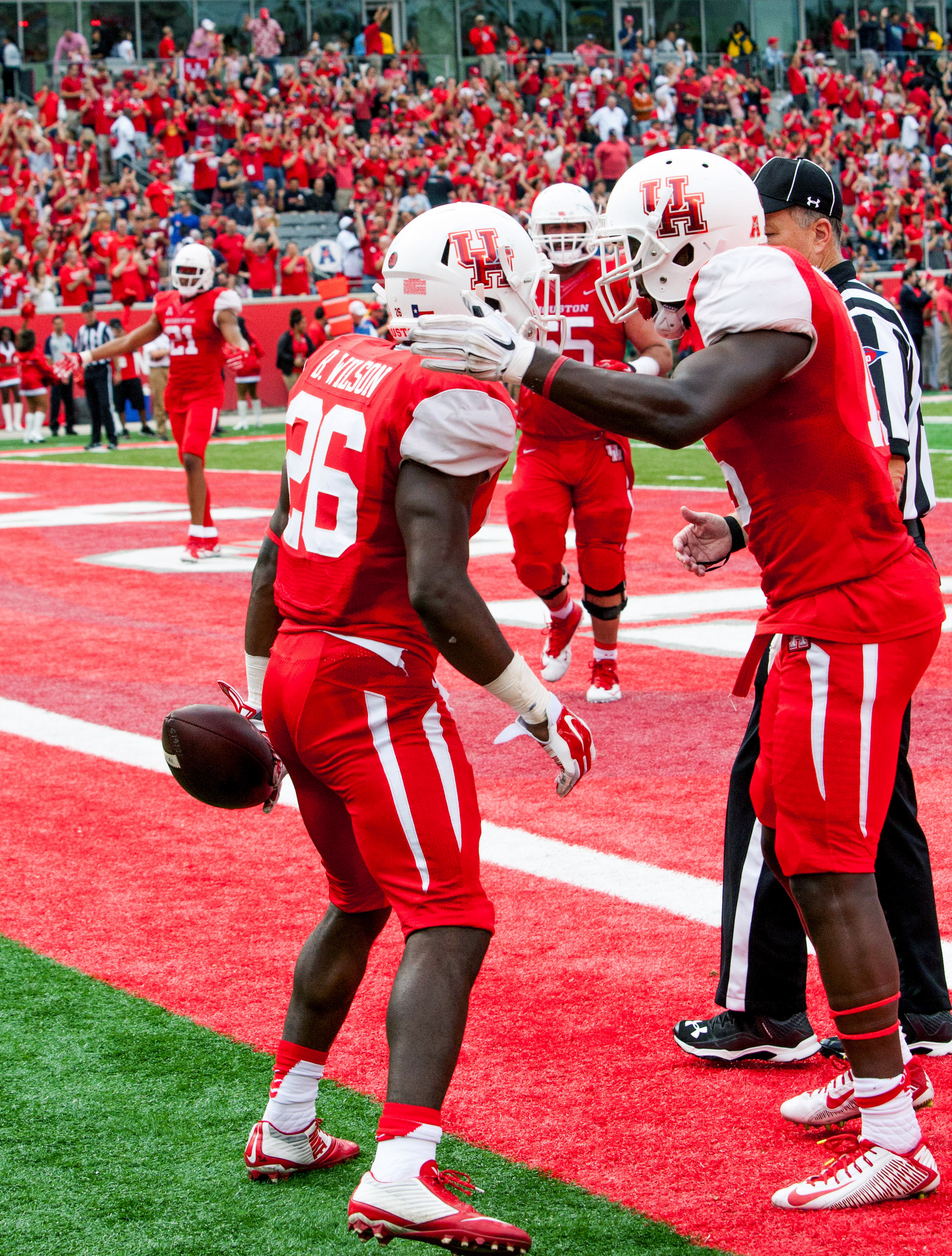 Houston's running back Tyreik Gray (26) celebrates with teammates in the end zone after scoring during the first quarter of an NCAA college football game against Navy Friday, Nov. 27, 2015, in Houston.  (AP Photo/Juan DeLeon)