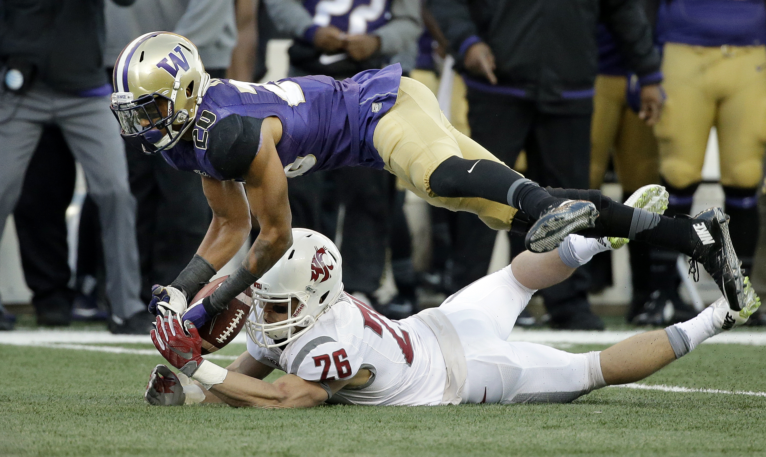 Washington defender Kevin King (20) knocks the ball away from Washington State's intended receiver, Tyler Baker, during the second half of an NCAA college football game Friday, Nov. 27, 2015, in Seattle. (AP Photo/Elaine Thompson)