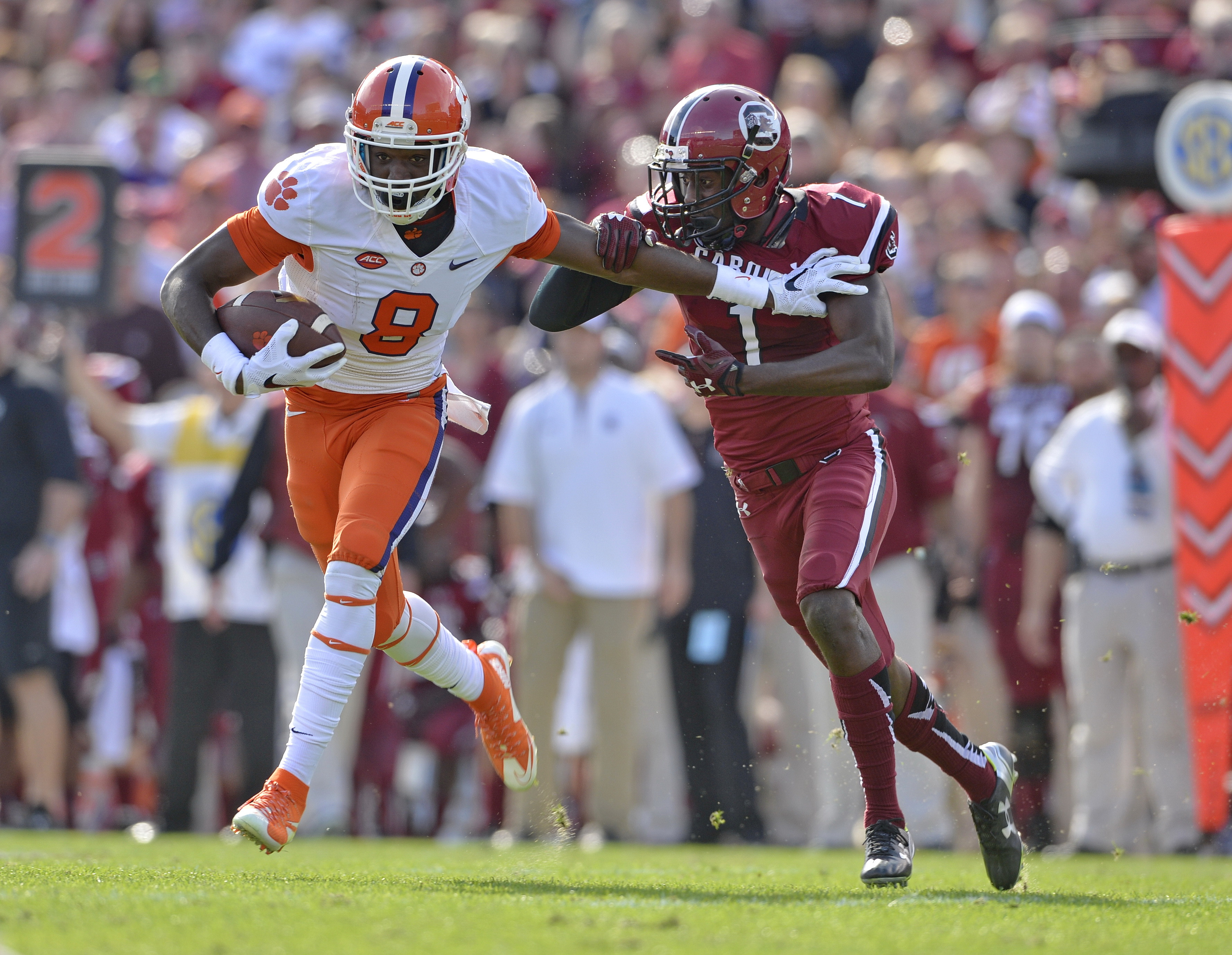 Clemson's Wayne Gallman runs through the tackle attempt of South Carolina's Rico McWilliams during the first half of an NCAA college football game Saturday,  Nov. 28, 2015,  in Columbia,  S.C. (AP Photo/Richard Shiro)