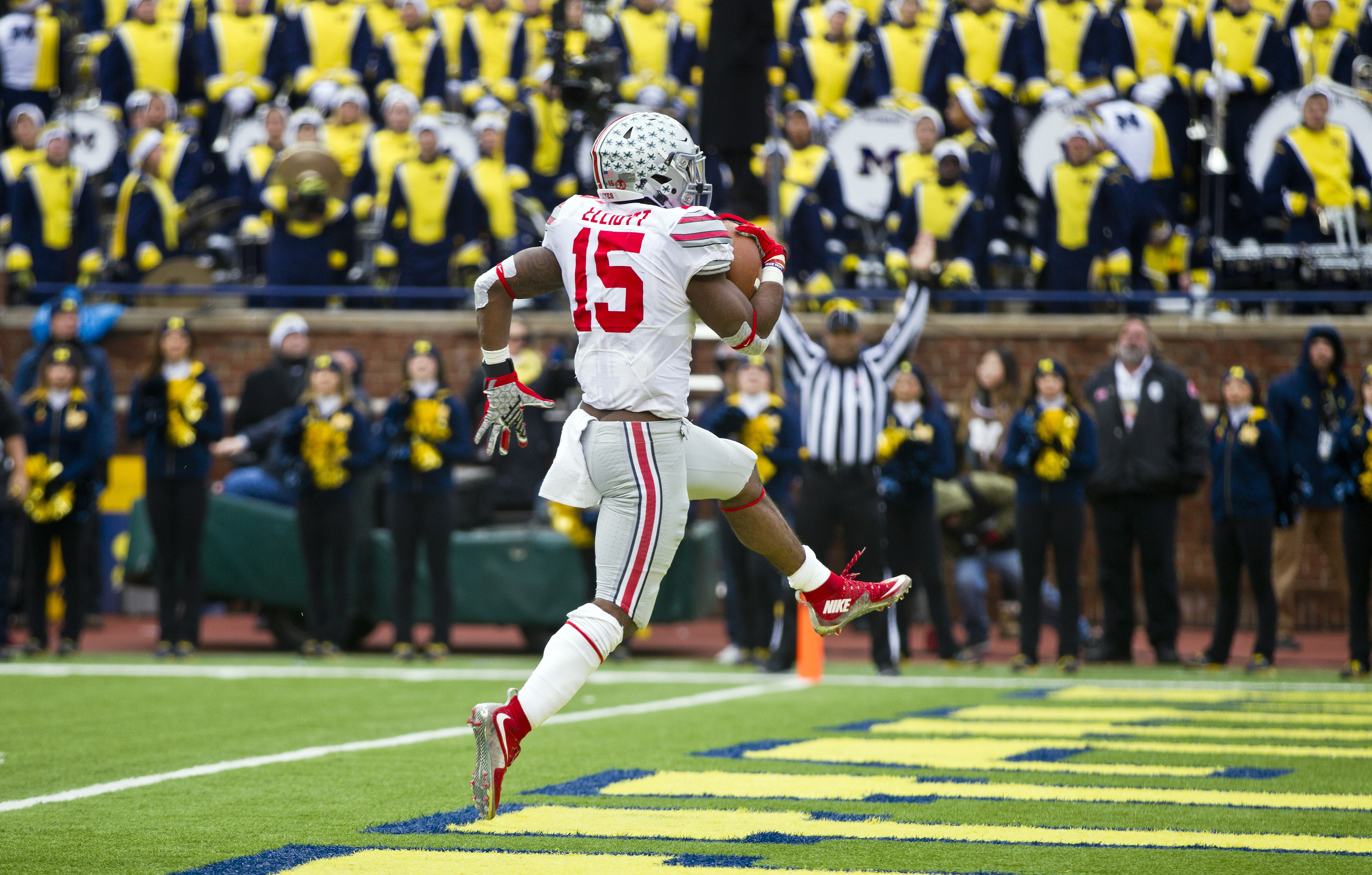 Ohio State running back Ezekiel Elliott (15) high steps into the end zone to score a touchdown in the second quarter of an NCAA college football game against Michigan in Ann Arbor, Mich., Saturday, Nov. 28, 2015. (AP Photo/Tony Ding)