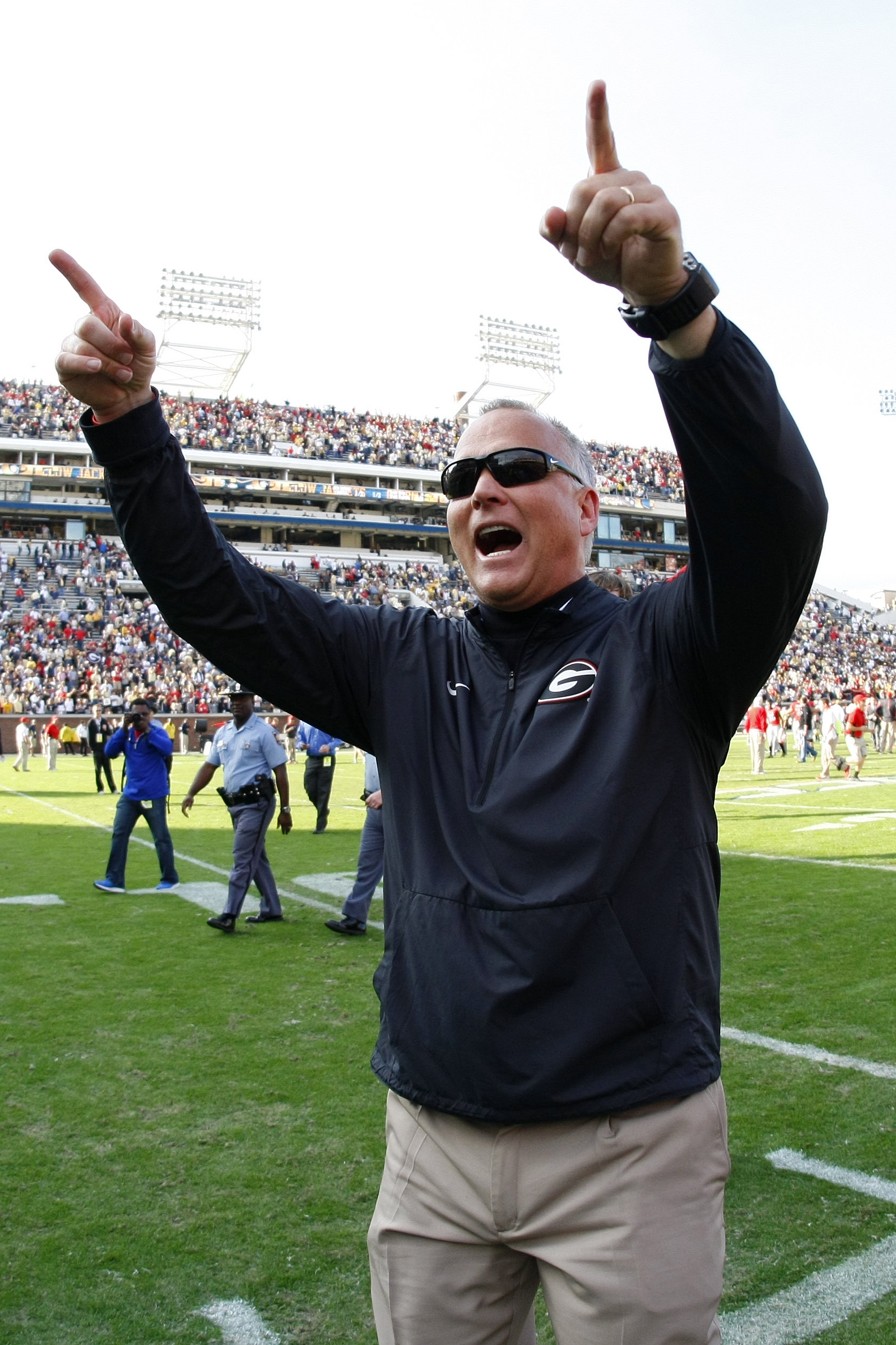 Georgia head coach Mark Richt celebrates as he walks off the field after they defeated Georgia Tech 13-7 in an NCAA college football game Saturday, Nov. 28, 2015, in Atlanta, Ga. (AP Photo/Brett Davis)