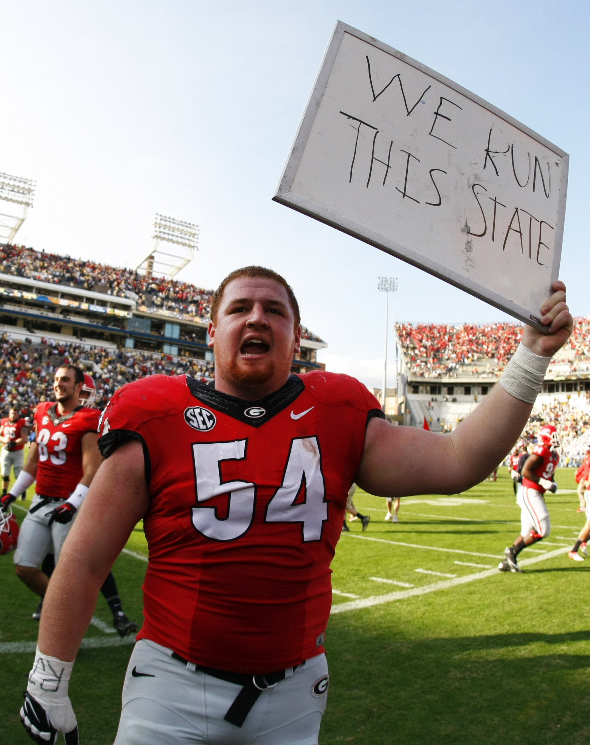 Georgia center Brandon Kublanow (54) celebrates after they defeated Georgia Tech 13-7 in an NCAA college football game Saturday, Nov. 28, 2015, in Atlanta, Ga. (AP Photo/Brett Davis)