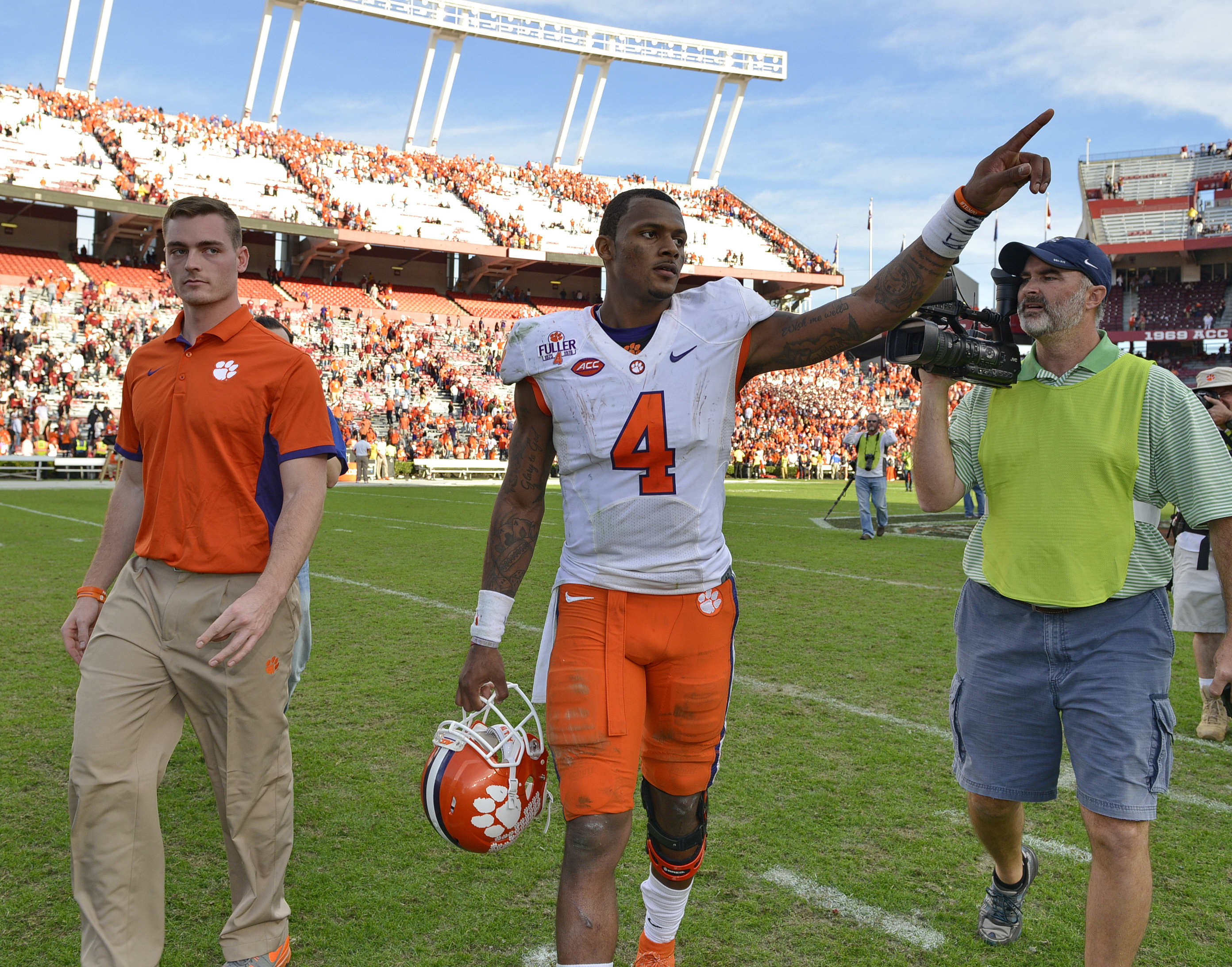 Clemson quarterback Deshaun Watson gestures to the fans after an NCAA college football game against South Carolina Saturday,  Nov. 28, 2015,  in Columbia,  S.C. Clemson won 37-32. (AP Photo/Richard Shiro)