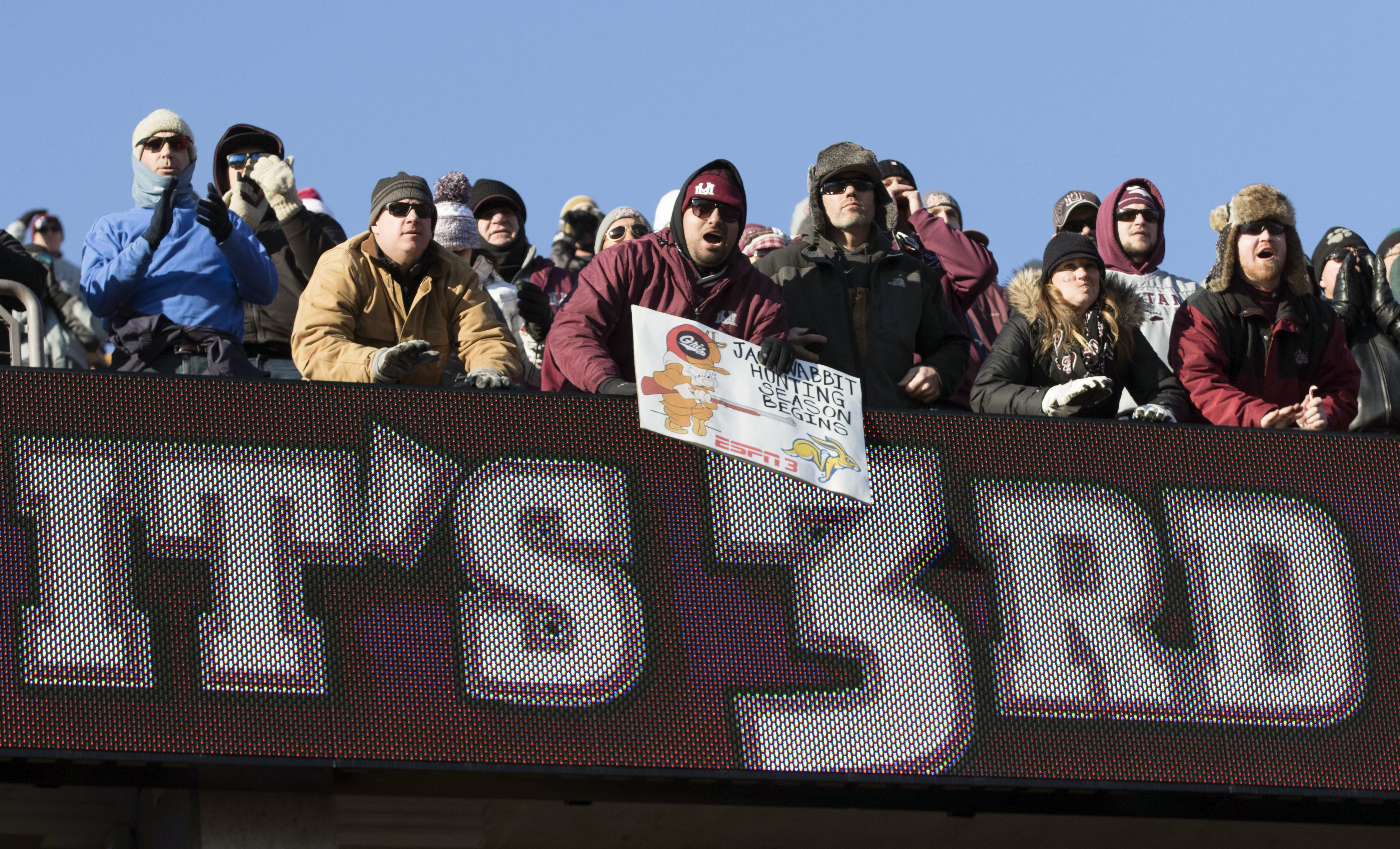 Montana fans make some noise while South Dakota State has the ball during the first half of a first round game in the NCAA college Football Championship Subdivision playoff, Saturday, Nov. 28, 2015, in Missoula, Mont. (AP Photo/Patrick Record)