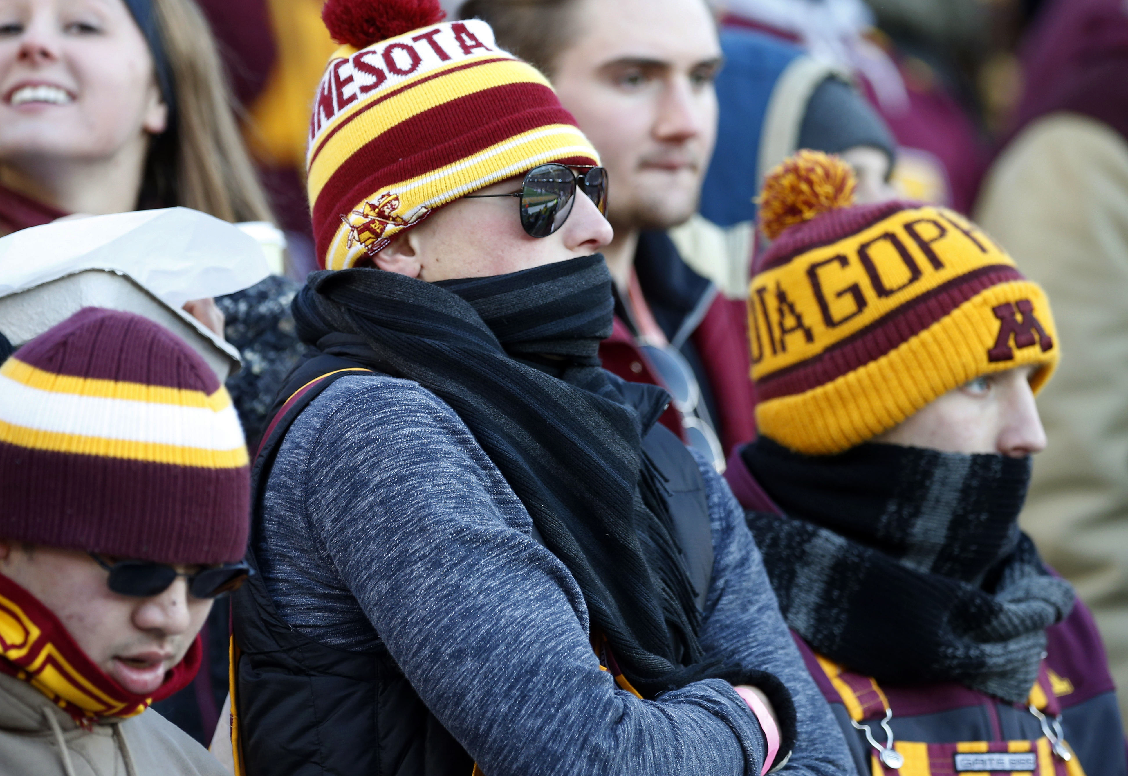 Minnesota fans brave the cold in the first half of an NCAA college football game between Minnesota and Wisconsin, Saturday, Nov. 28, 2015, in Minneapolis. (AP Photo/Jim Mone)