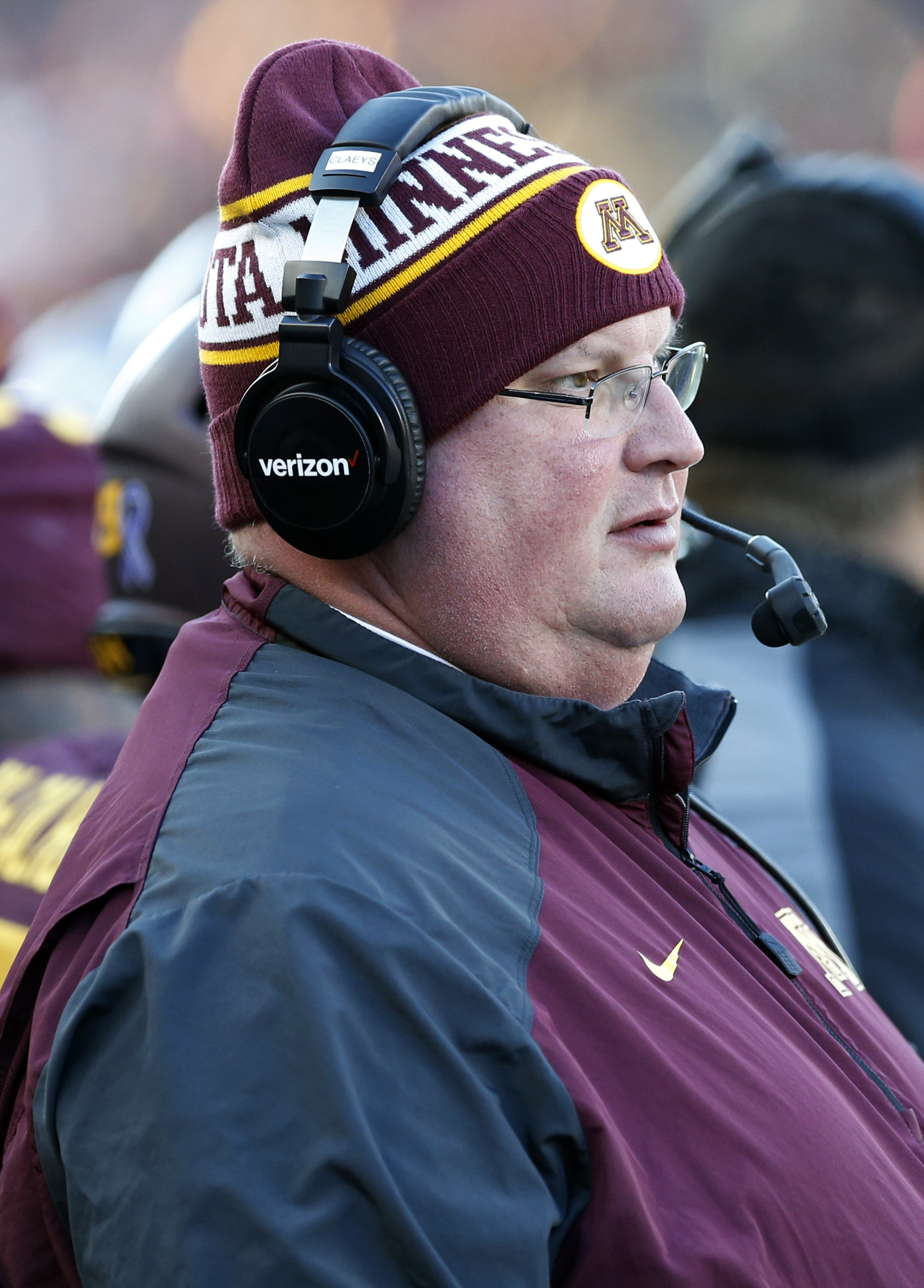 Minnesota head coach Tracy Claeys watches in the first half of an NCAA college football game against Wisconsin, Saturday, Nov. 28, 2015, in Minneapolis. (AP Photo/Jim Mone)