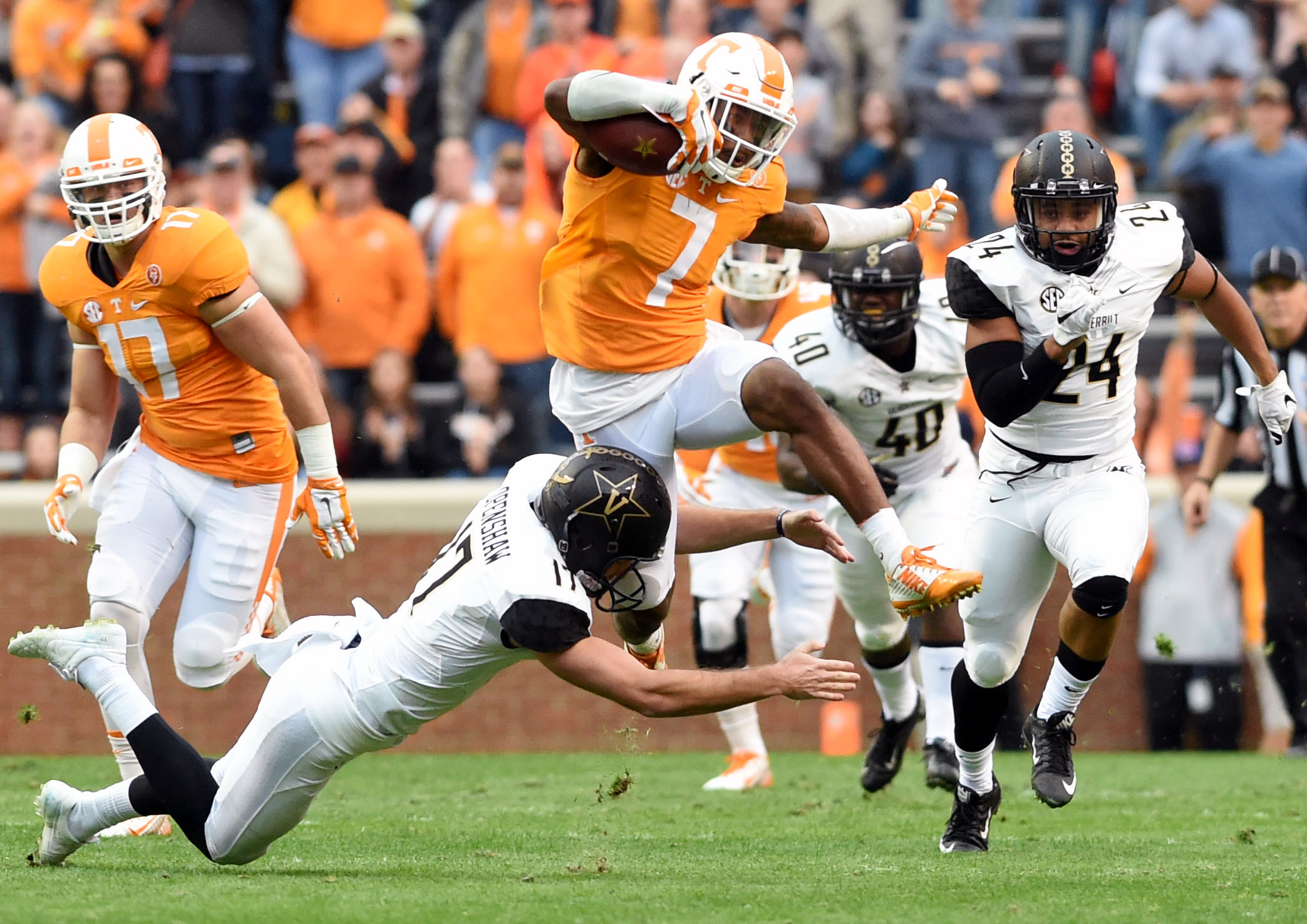 CORRECTS TO TENNESSEE DEFENSIVE BACK CAMERON SUTTON (7) FROM TENNESSEE WIDE RECEIVER PRESTON WILLIAMS (7) - Tennessee defensive back Cameron Sutton (7) leaps over Vanderbilt placekicker Tommy Openshaw (17) during the first half of an NCAA college football