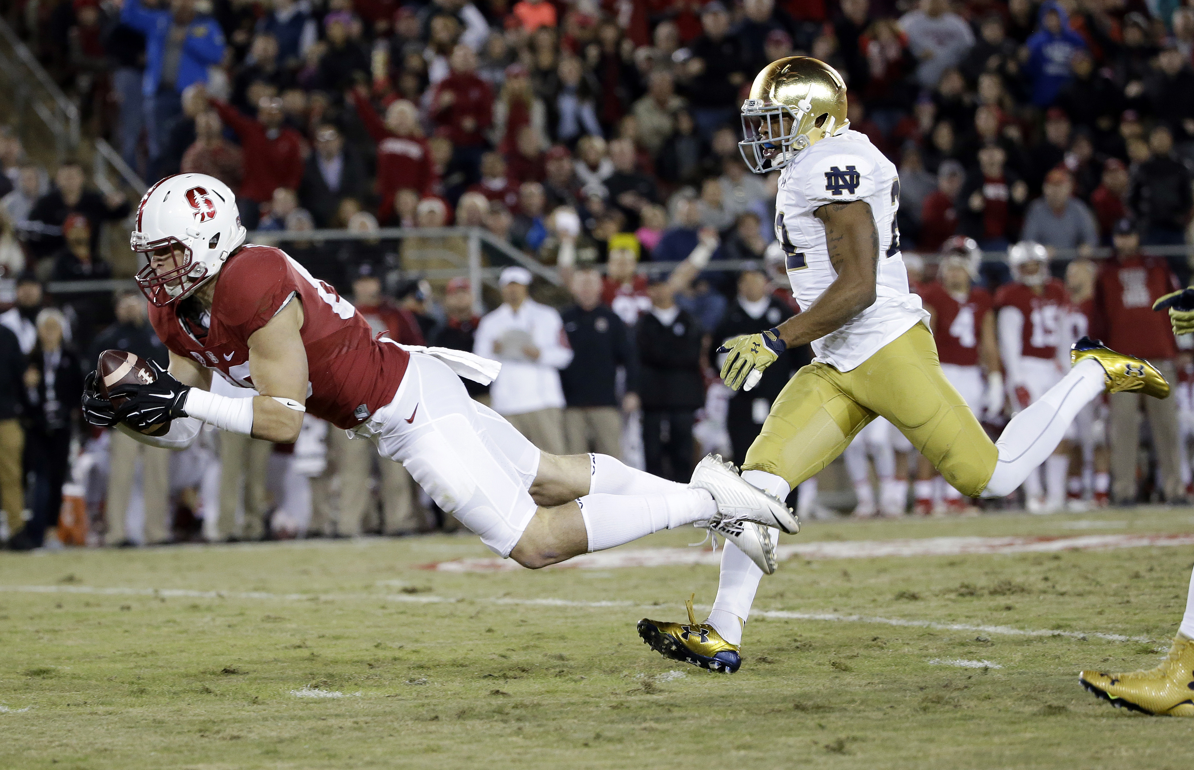 Stanford wide receiver Devon Cajuste, left, makes a catch next to Notre Dame safety Elijah Shumate during the first half of an NCAA college football game Saturday, Nov. 28, 2015, in Stanford, Calif. (AP Photo/Marcio Jose Sanchez)