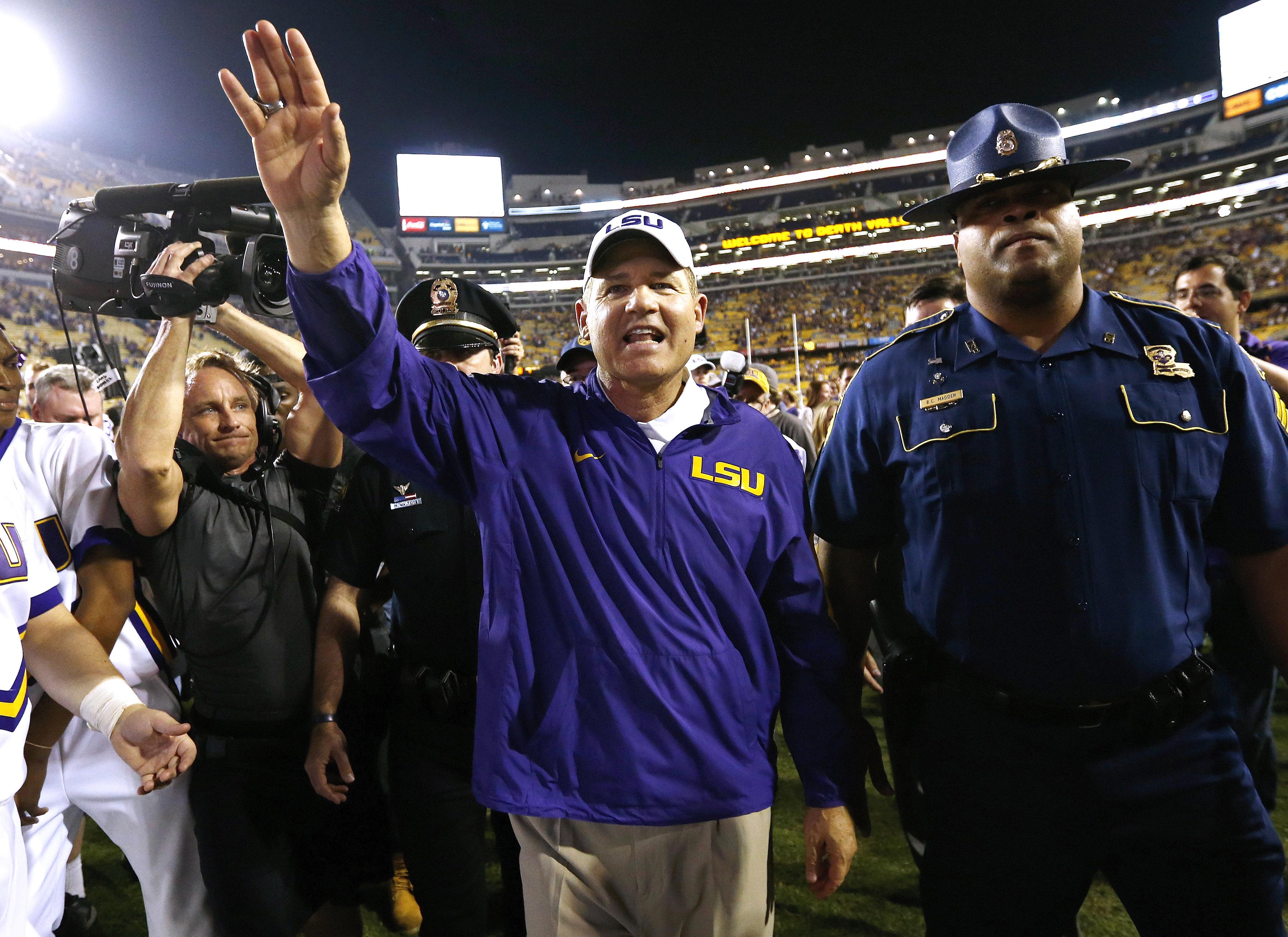 LSU head coach Les Miles celebrates after an NCAA college football game against Texas A&M in Baton Rouge, La., Saturday, Nov. 28, 2015. LSU won 19-7. (AP Photo/Jonathan Bachman)