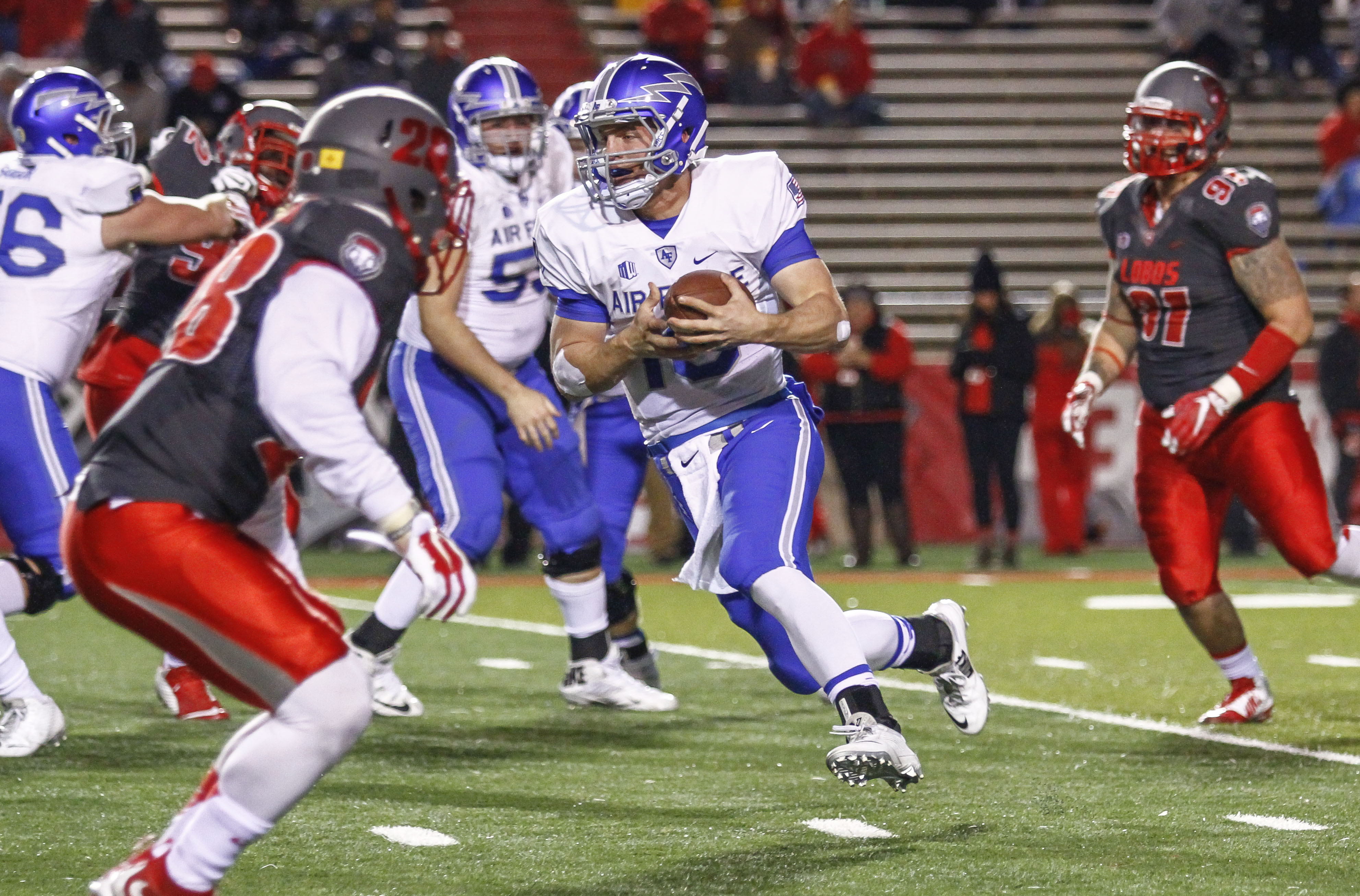 Air Force's Carson Roberts (16) carries against New Mexico during the first half of an NCAA college football game, Saturday, Nov. 28, 2015, in Albuquerque, N.M. (AP Photo/Juan Labreche)