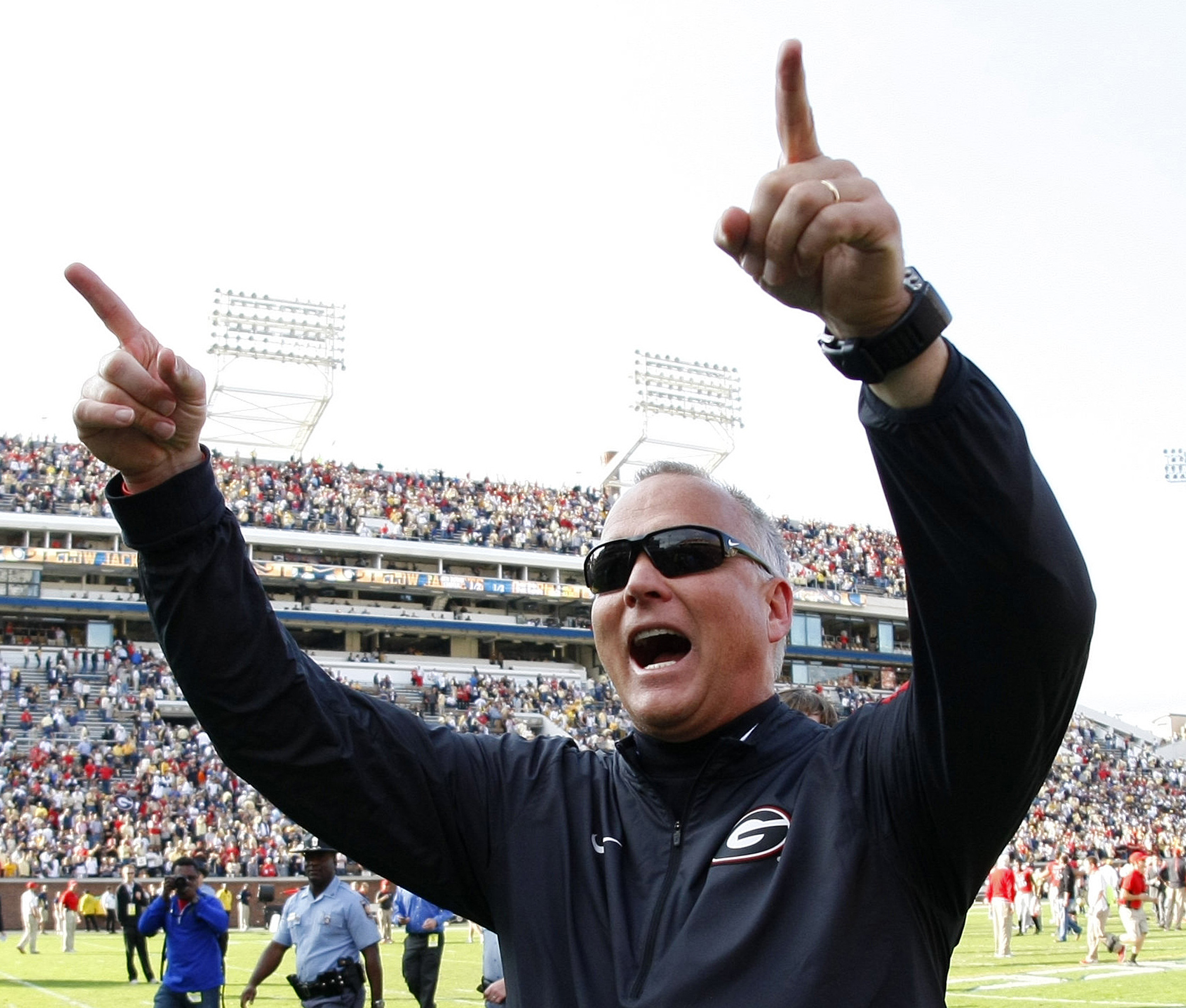 FILE - In this Nov. 28, 2015, file photo, Georgia head coach Mark Richt celebrates as he walks off the field after his team defeated Georgia Tech 13-7 in an NCAA college football game in Atlanta, Ga. Richt is stepping down after 15 seasons in what is bein