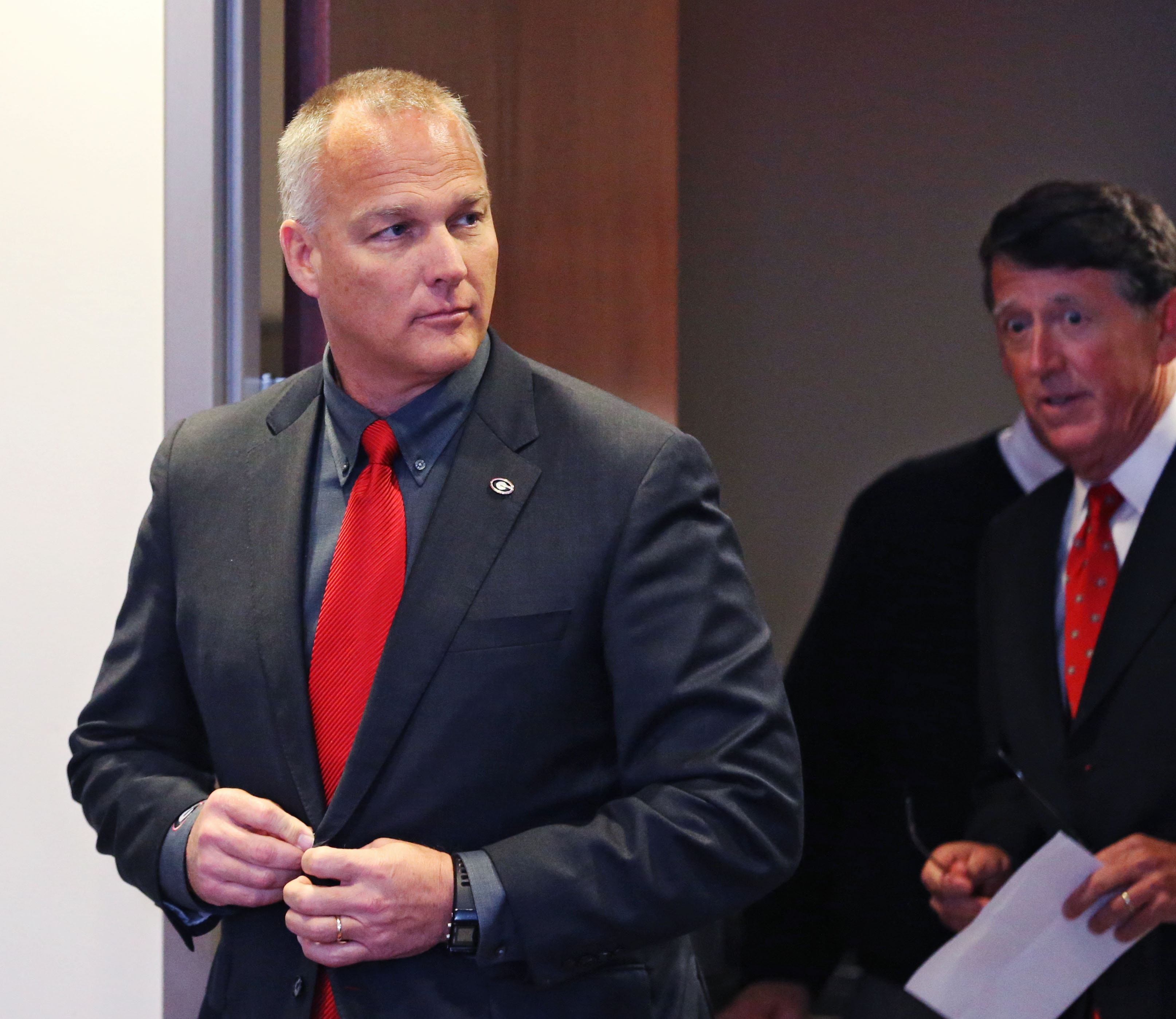 University of Georgia head football coach Mark Richt enters a press conference Monday, Nov. 30, 2015, ahead of athletics director Greg McGarity, in Athens, Ga., at press conference officially marking his dismissal as the Bulldogs' head football coach. Geo