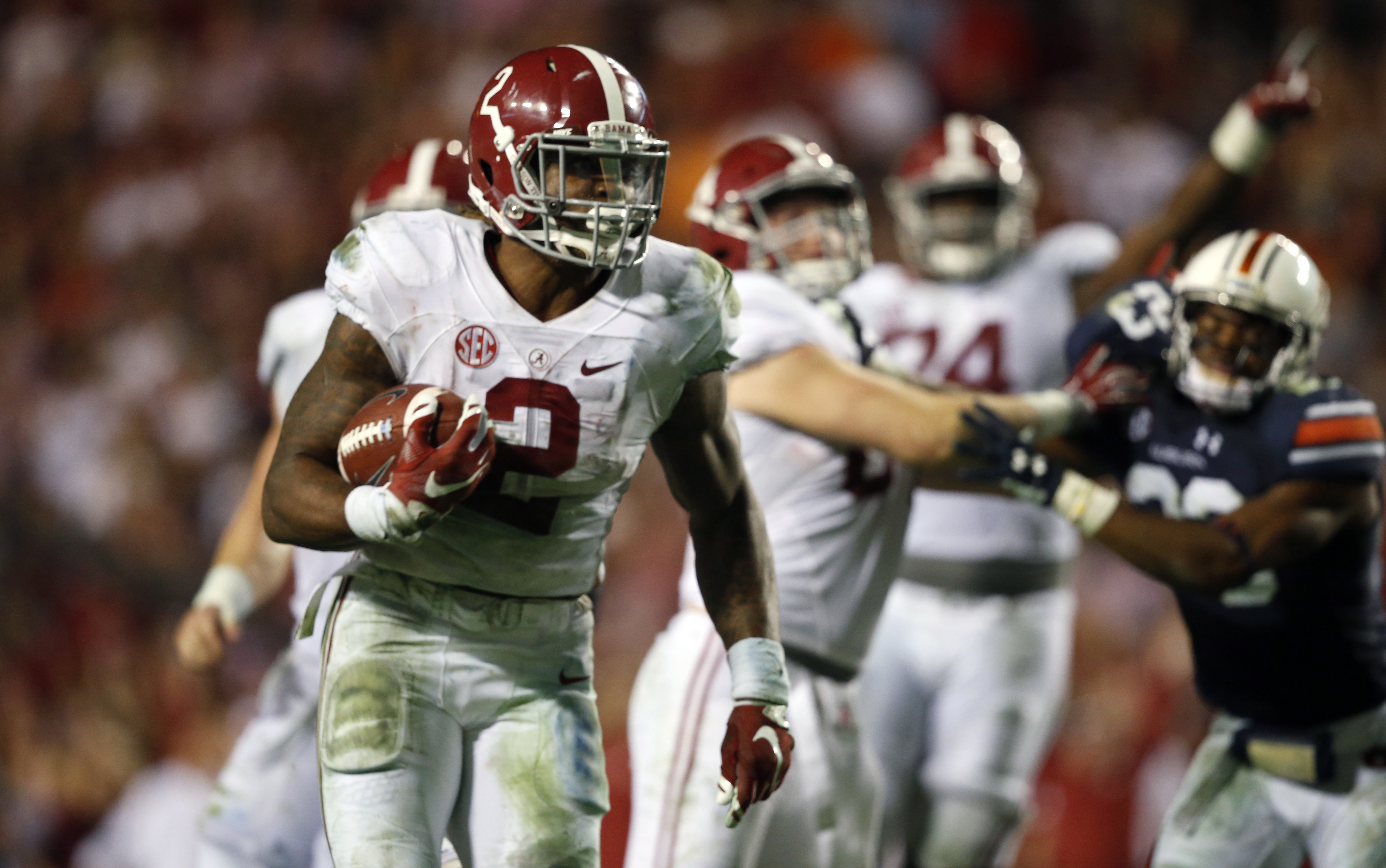 FILE - In this Nov. 28, 2015, file photo, Alabama running back Derrick Henry (2) runs the ball and scores a touchdown during the second half of an NCAA college football game against Auburn in Auburn, Ala. No. 2 Alabama's offensive methods have changed but