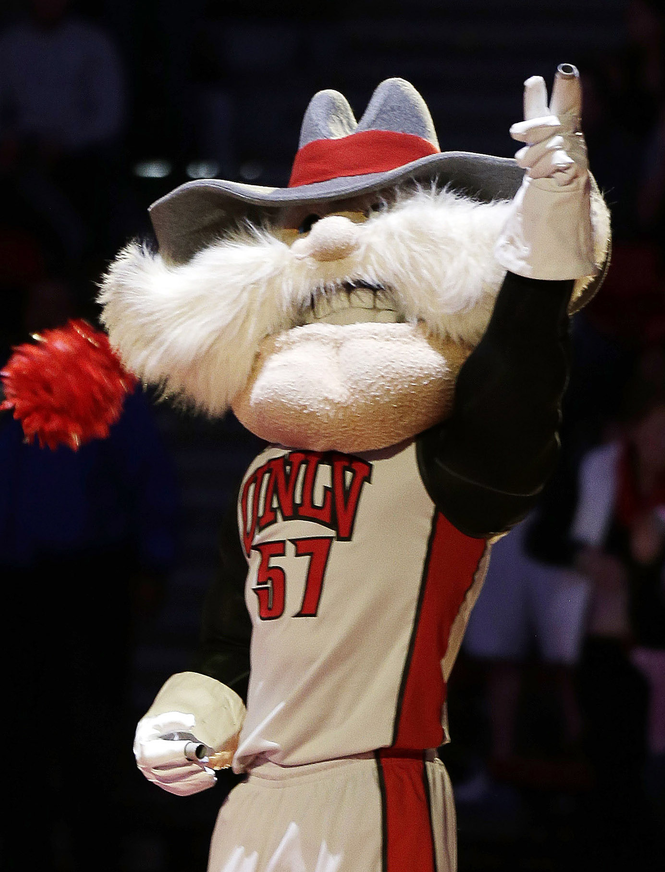 "FILE - In this Feb. 1, 2014, file photo, UNLV mascot Hey Reb warms up the crowd before an NCAA college basketball game in Las Vegas. UNLV President Len Jessup says the school needs to keep ""Rebels"" as its nickname after new research concluded it is not a"