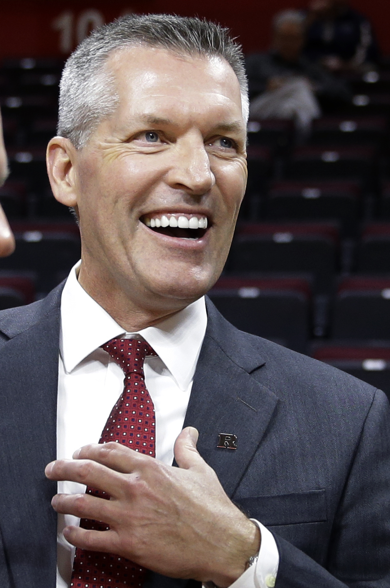 Rutgers new athletic director Patrick Hobbs, Dean Emeritus of the Seton Hall University School of Law, stands on the court before an NCAA college basketball game against Wake Forest, Monday, Nov. 30, 2015, in Piscataway, N.J. Rutgers fired football coach