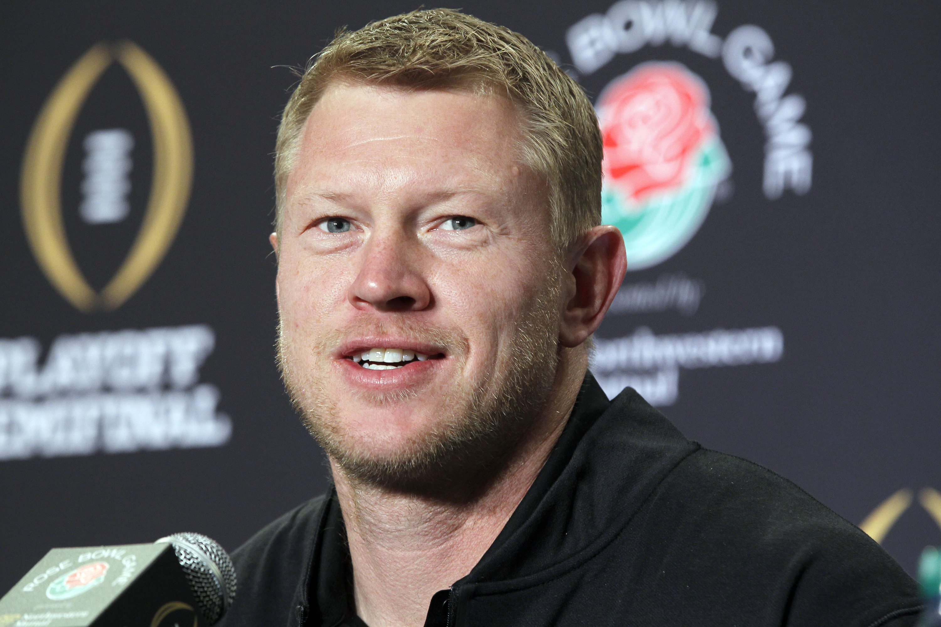 FILE - In this Dec. 30, 2014, file photo, Oregon offensive coordinator Scott Frost talks to reporters during a news conference in Los Angeles. Central Florida has hired Oregon offensive coordinator Scott Frost as its new coach to take over a program that