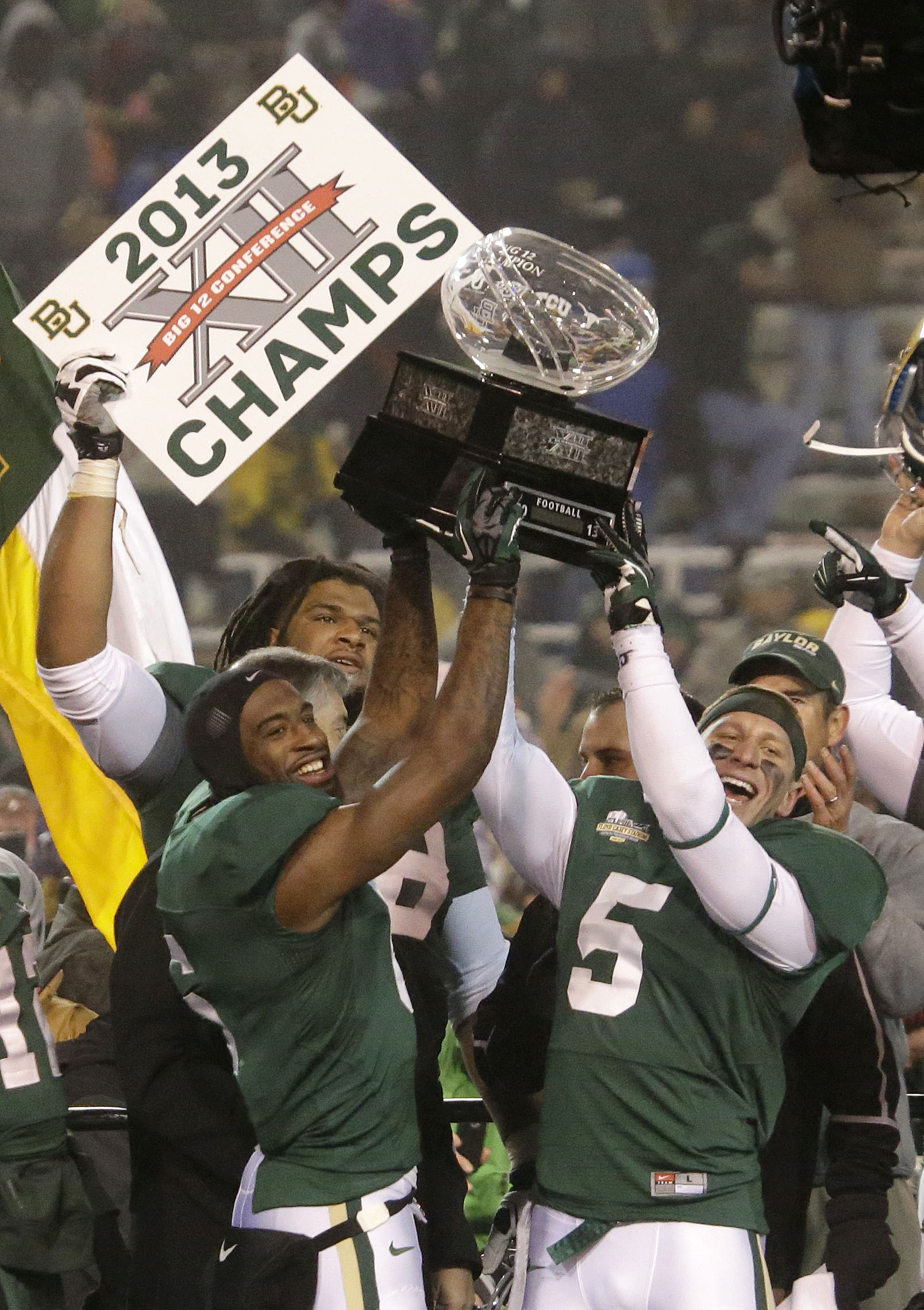 FILE - In this Dec. 7, 2013, file photo, Baylor safety Ahmad Dixon, left, and linebacker Eddie Lackey (5) lift the Big 12 trophy after their NCAA college football game against Texas in Waco, Texas. Oklahoma has already clinched its ninth Big 12 title outr