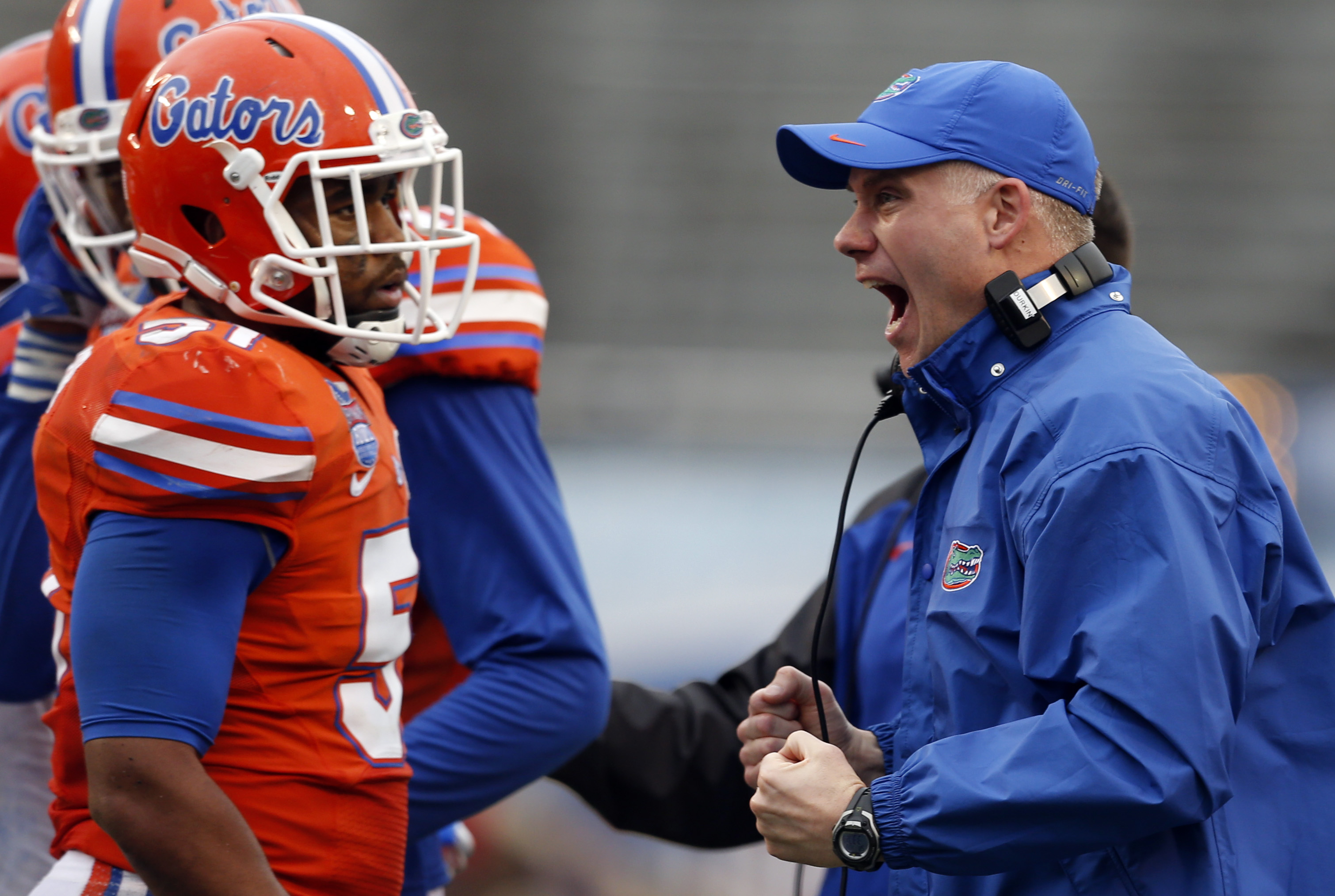 FILE - In this Jan. 3, 2015, file photo, Florida interim coach D.J. Durkin reacts after a defensive stop against East Carolina during the second half of the Birmingham Bowl NCAA college football game in Birmingham, Ala. Maryland has hired Durkin, who was