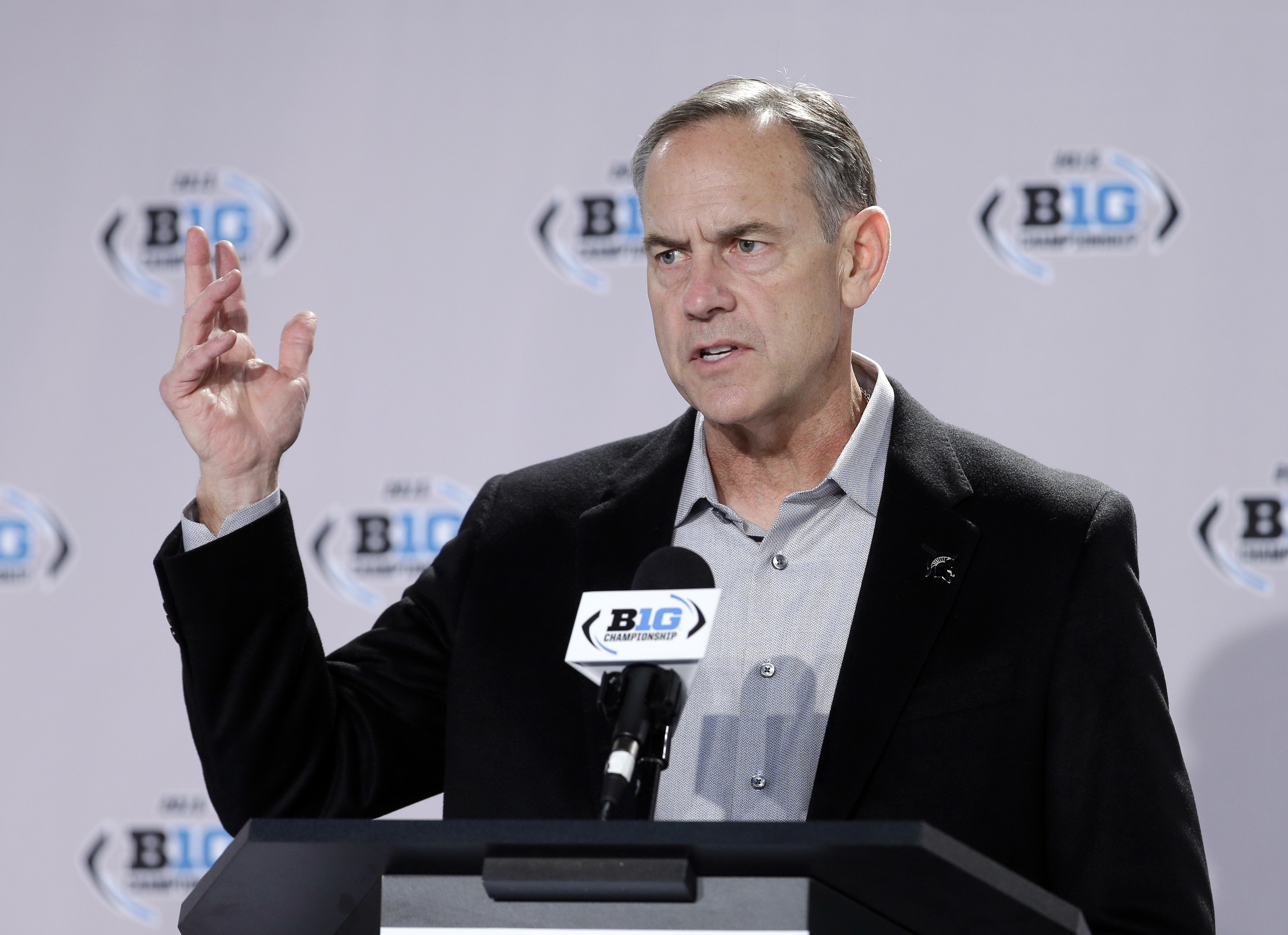 Michigan State head coach Mark Dantonio responds to a question during a news conference for the Big Ten Conference championship NCAA college football game Friday, Dec. 4, 2015, in Indianapolis. Iowa will play Michigan State Saturday for the championship.