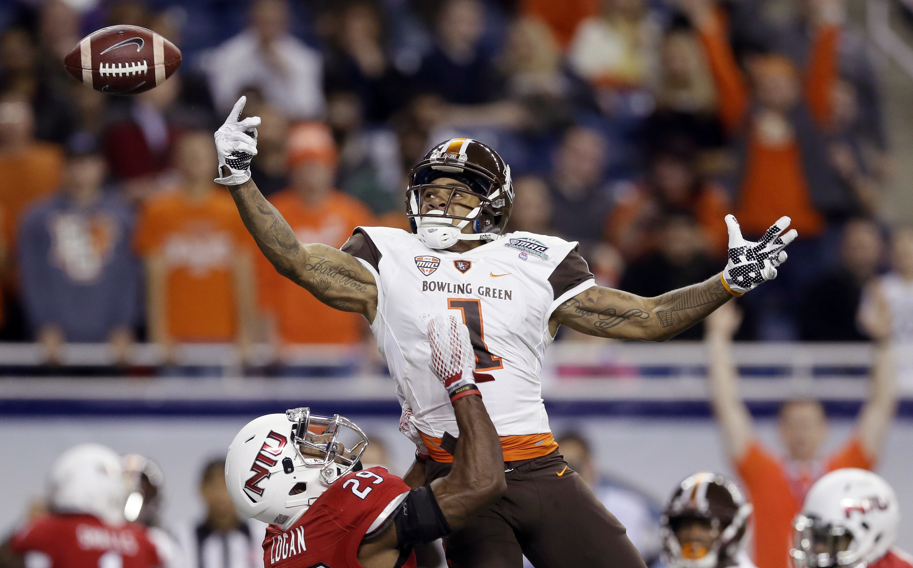 Bowling Green wide receiver Roger Lewis, top, defended by Northern Illinois cornerback Paris Logan (29) is unable to reach a pass in the end zone during the first half of the Mid-American Conference championship NCAA college football game, Friday, Dec. 4,