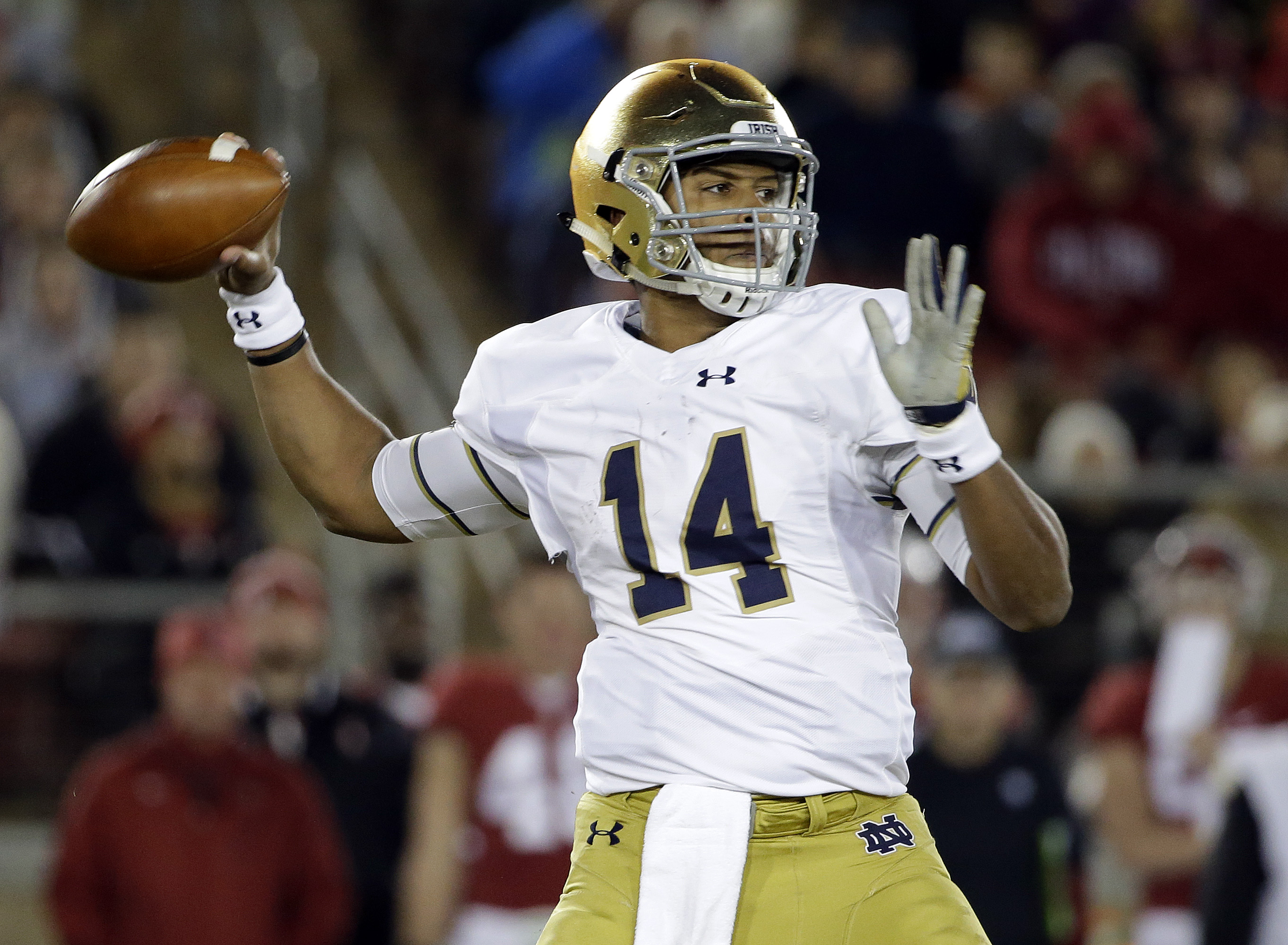 FILE - In this Nov. 28, 2015 file photo, Notre Dame quarterback DeShone Kizer throws against Stanford during the first half of an NCAA college football game, in Stanford, Calif. Life has been a blur for Kizer since being thrust into the starter's role whe