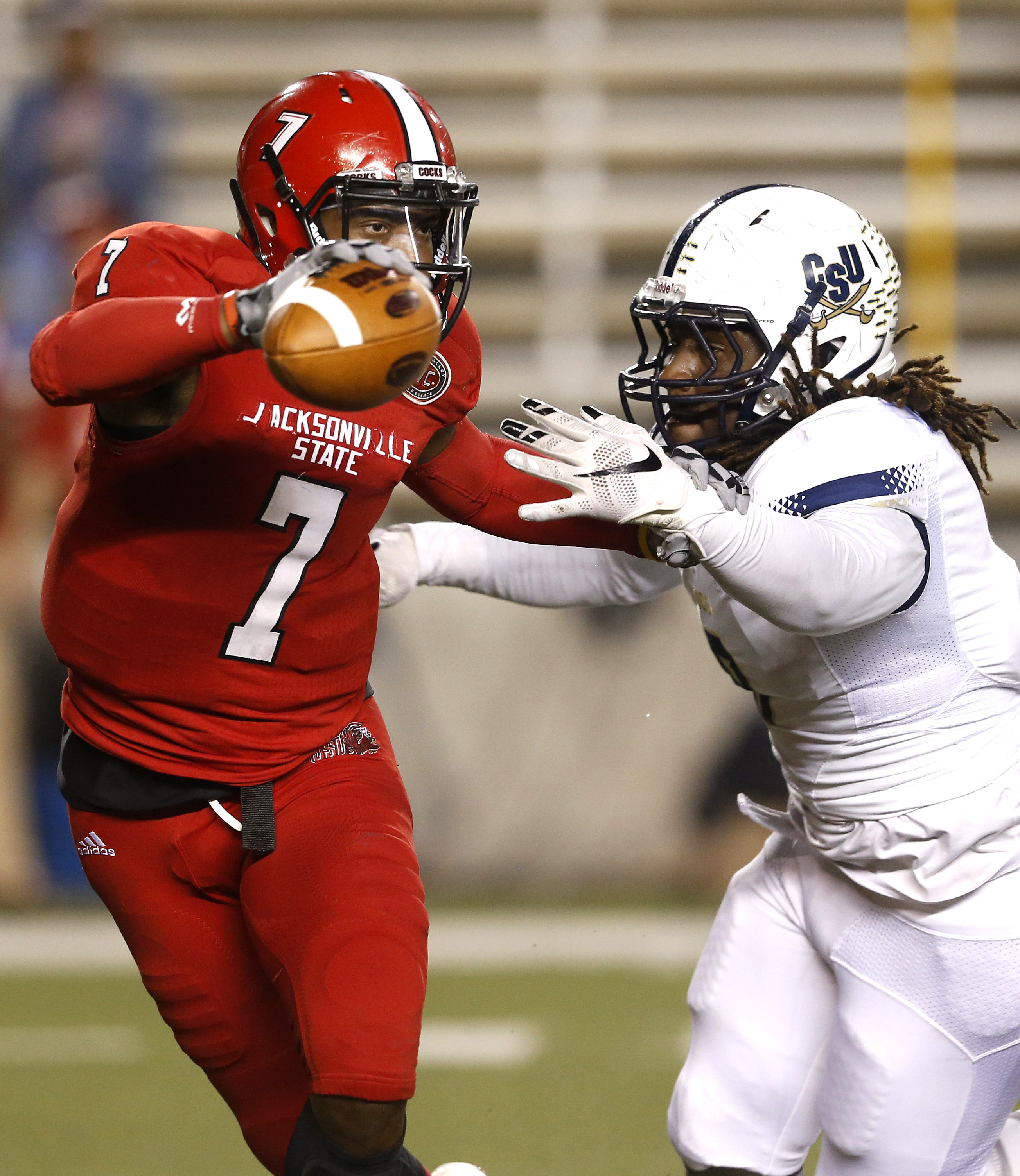 Jacksonville State quarterback Eli Jenkins (7) is pressured and sacked by Charleston Southern Anthony Ellis (8) during the first half of an NCAA college football game, Friday, Dec. 11, 2015, in Jacksonville, Ala. (AP Photo/ Butch Dill)