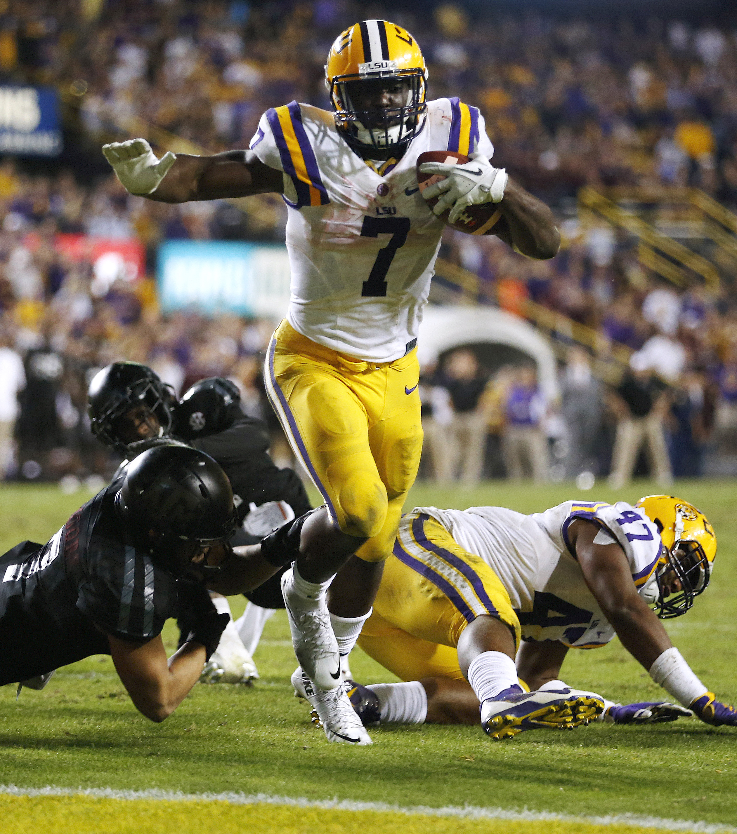 FILE - In this Saturday, Nov. 28, 2015, file photo, LSU running back Leonard Fournette (7) scores a touchdown during the second half of an NCAA college football game against Texas A&M in Baton Rouge, La. Fournette has been named to the AP All-America foot
