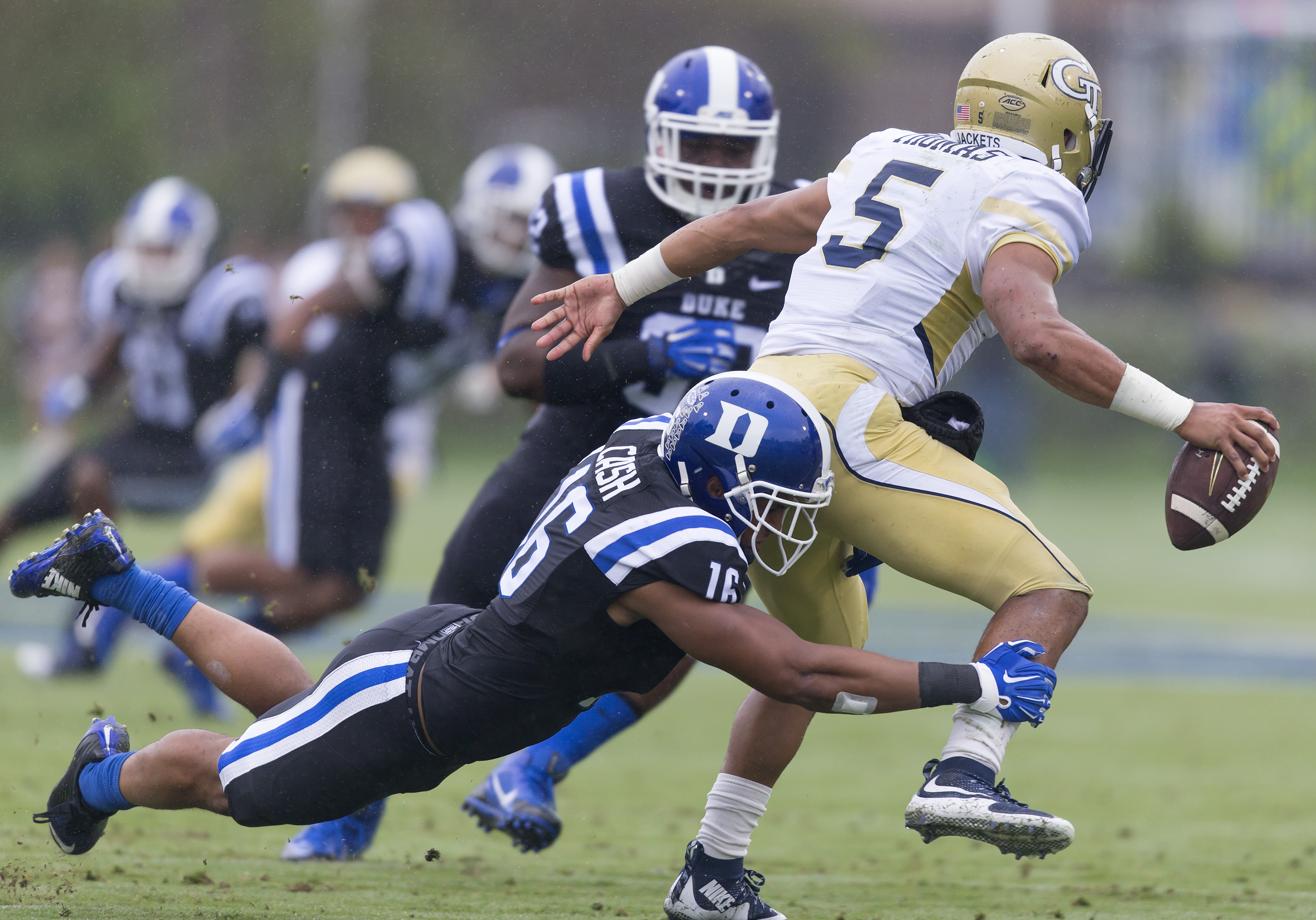 FILE - In this Sept. 26, 2015, file photo, Duke's Jeremy Cash tackles Georgia Tech's Justin Thomas for a loss during the first half of an NCAA college football game, in Durham, N.C. Cash has been named to the AP All-American football team. (AP Photo/Rob B