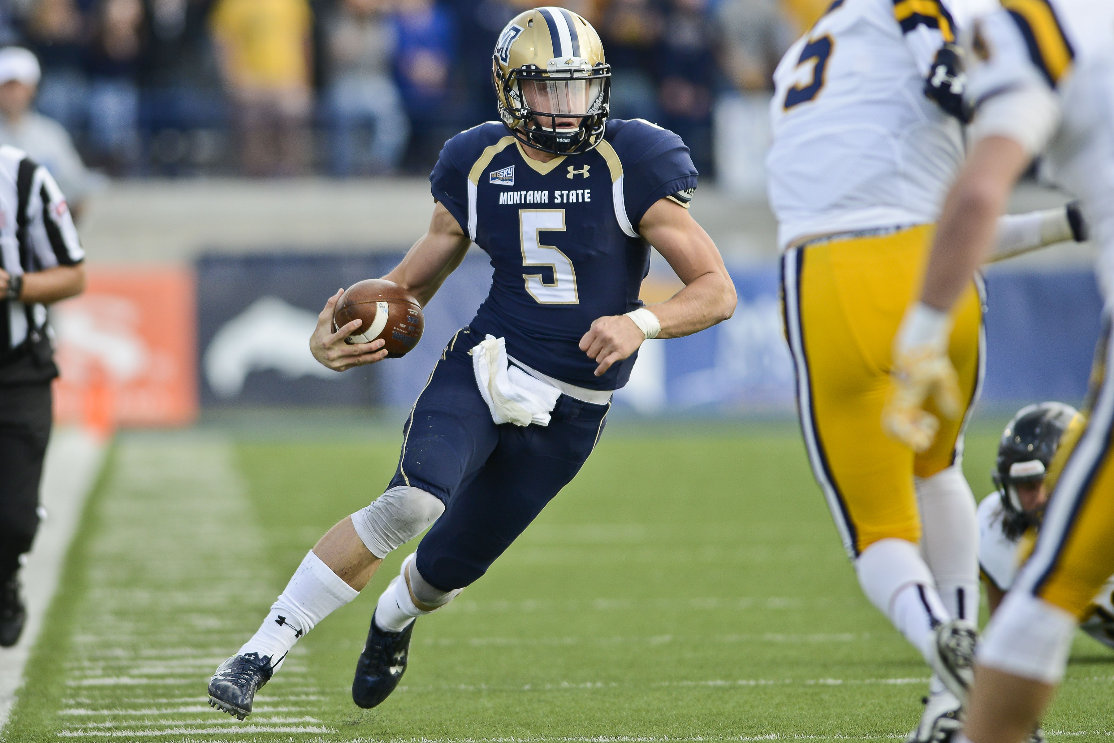 FILE - In this Saturday, Oct. 24, 2015 file photo, Montana State quarterback Dakota Prukop runs the ball against East Tennessee State during the first half of an NCAA college football game in Bozeman, Mont. (Adrian Sanchez-Gonzalez/Bozeman Daily Chronicle