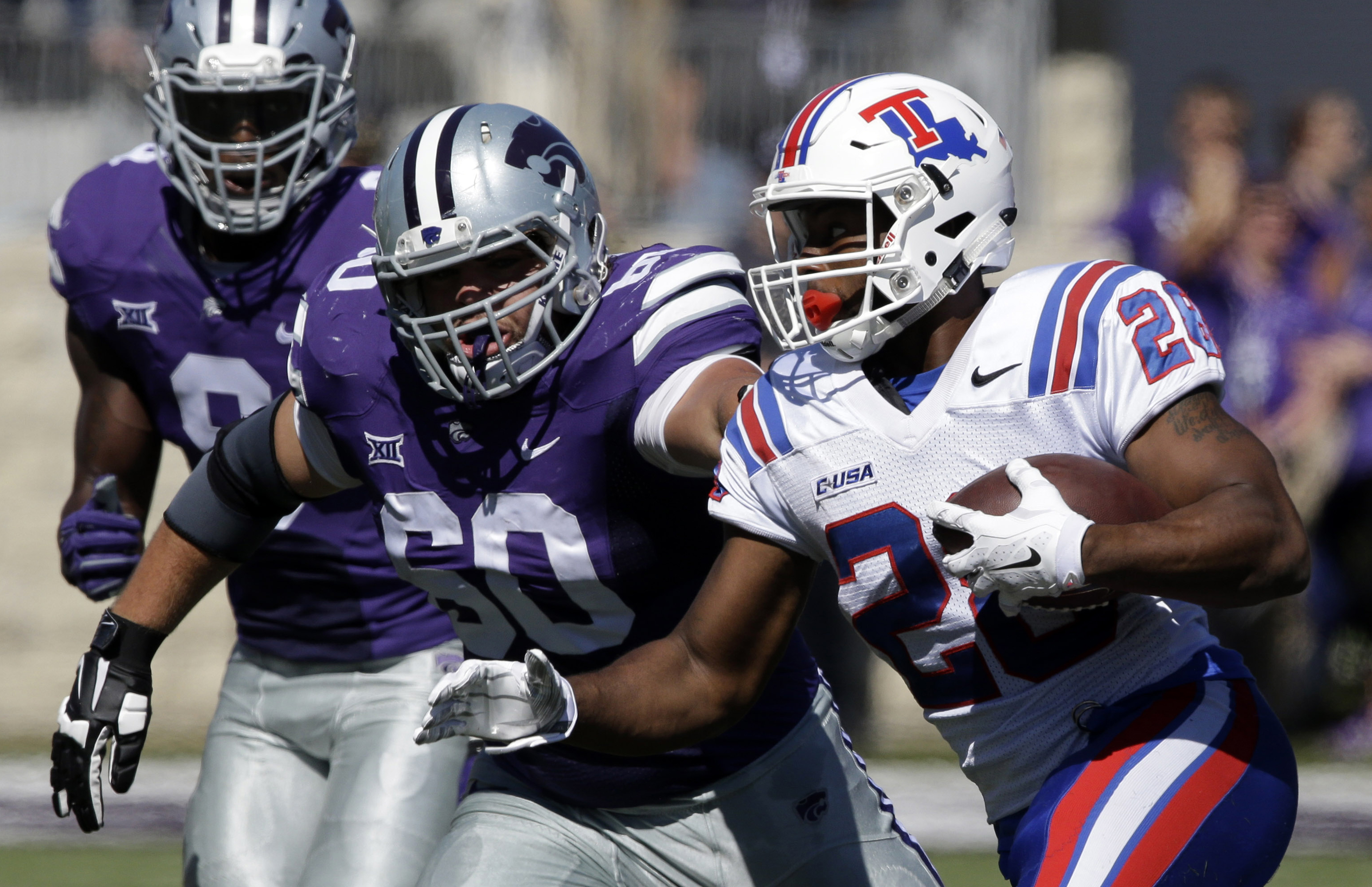FILE - In this Sept. 19, 2015, file photo, Louisiana Tech running back Kenneth Dixon (28) runs the ball against Kansas State defensive tackle Will Geary (60) during the first half of an NCAA college football game in Manhattan, Kan. With 83 career touchdow