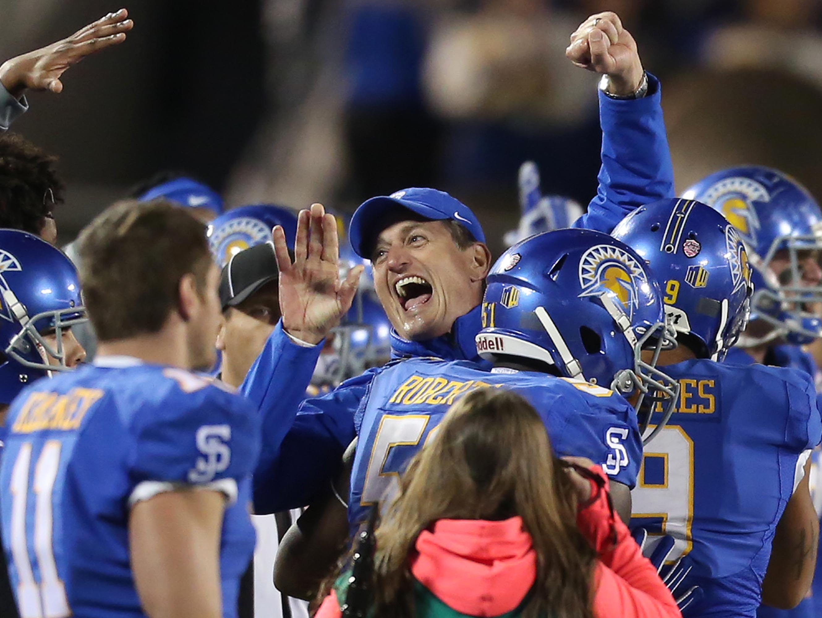 San Jose State head coach Ron Caragher celebrates after defeating Georgia State in the Cure Bowl NCAA college football game, Saturday, Dec. 19, 2015 in Orlando, Fla. (Stephen M. Dowell/Orlando Sentinel via AP) MAGS OUT; NO SALES; MANDATORY CREDIT