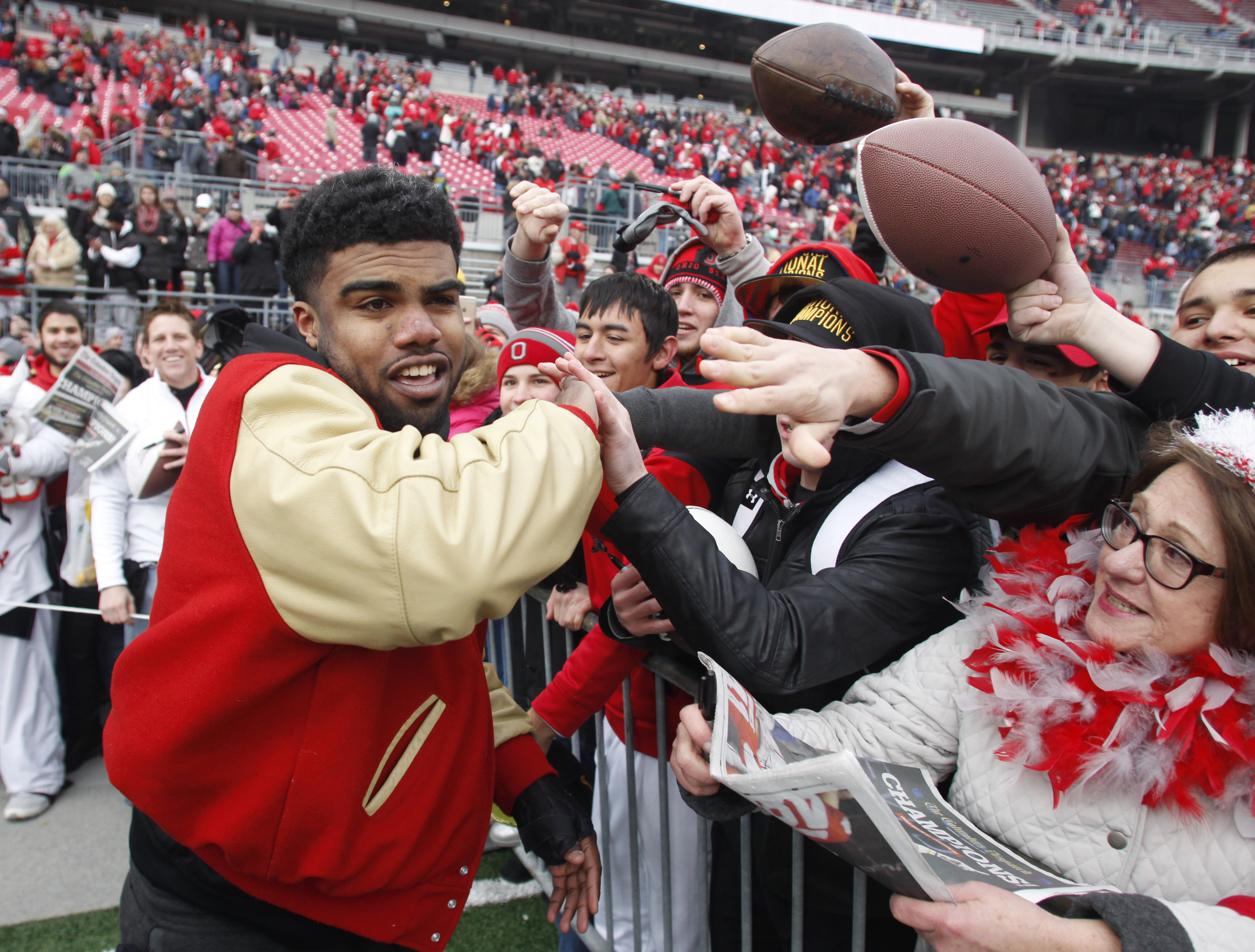 This Jan. 24, 2015 file photo shows Ohio State running back Ezekiel Elliott greeting fans during a celebration of the Buckeye's 2014 College Football Playoff national championship at Ohio Stadium in Columbus, Ohio. (AP Photo/Paul Vernon, File)