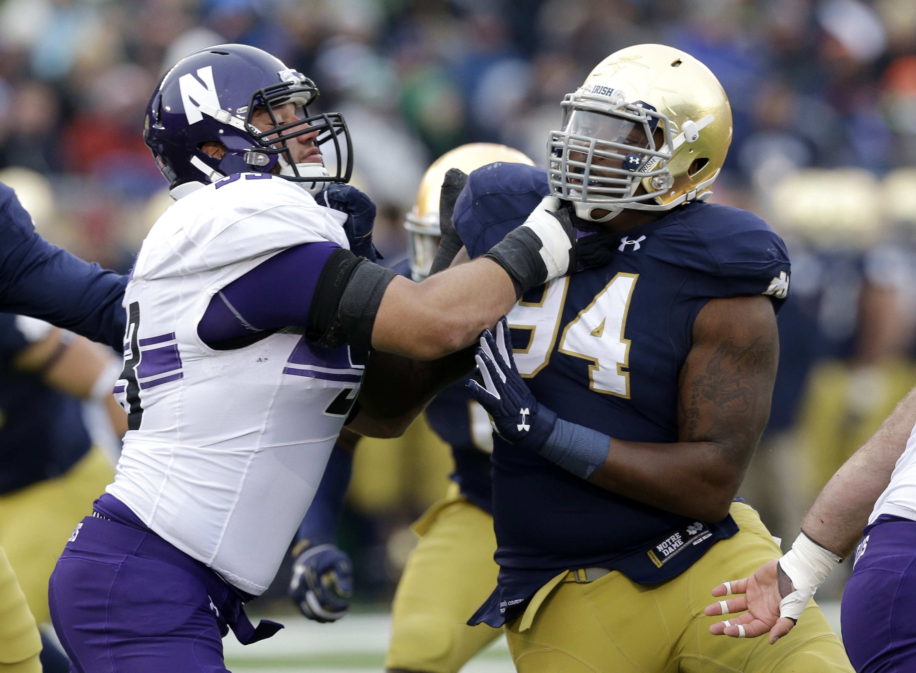 FILE - In this Nov. 15, 2014, file photo, Notre Dame's Jarron Jones (94) rushes against Northwestern offensive lineman Geoff Mogus (53) during the first half of an NCAA college football game in South Bend, Ind. Jones, who hasn't played in a game since the