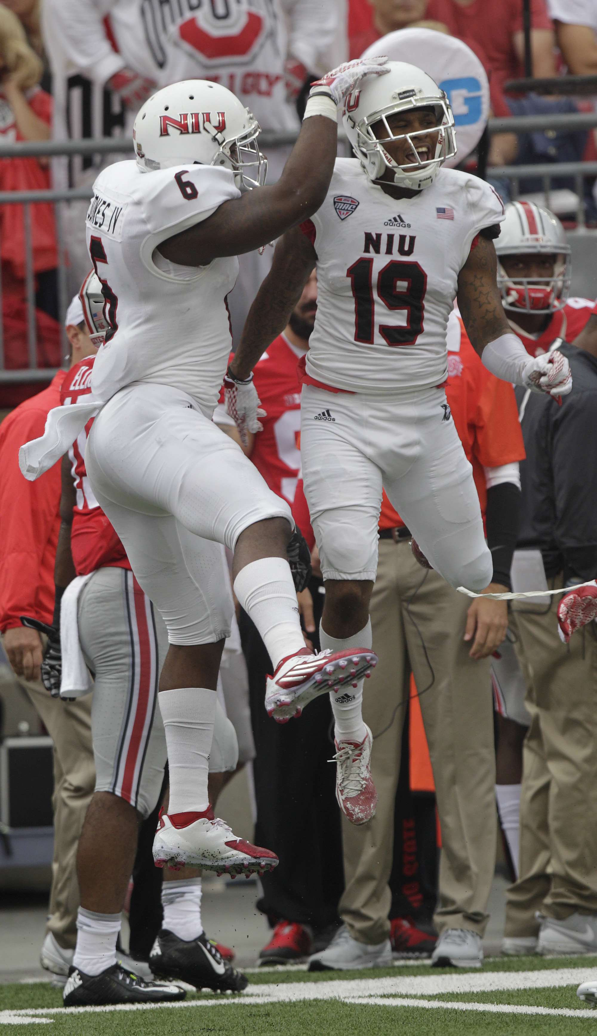FILE - In this Sept. 19, 2015, file photo, Northern Illinois defenders Bobby Jones, left, and Shawun Lurry celebrate Lurry's interception against Ohio State during the second quarter of an NCAA college football game in Columbus, Ohio. It was just the begi