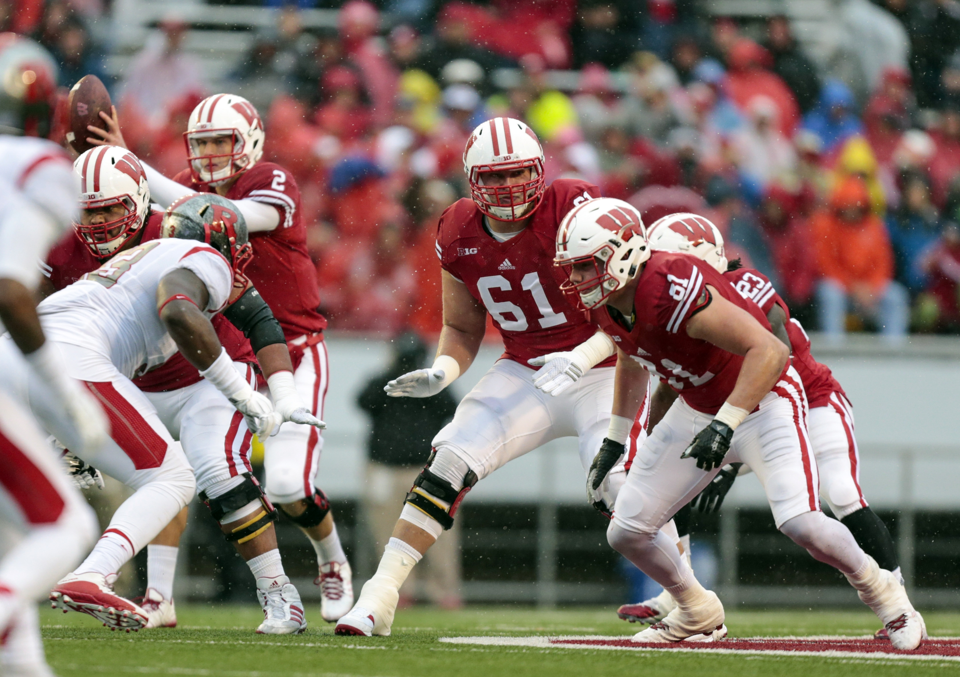 FILE - In this Oct. 31, 2015, file photo, Wisconsin offensive lineman Tyler Marz (61) blocks during the first half of an NCAA college football game against Rutgers in Madison, Wis. Wisconsin hopes its running game can build on the success it had in its re