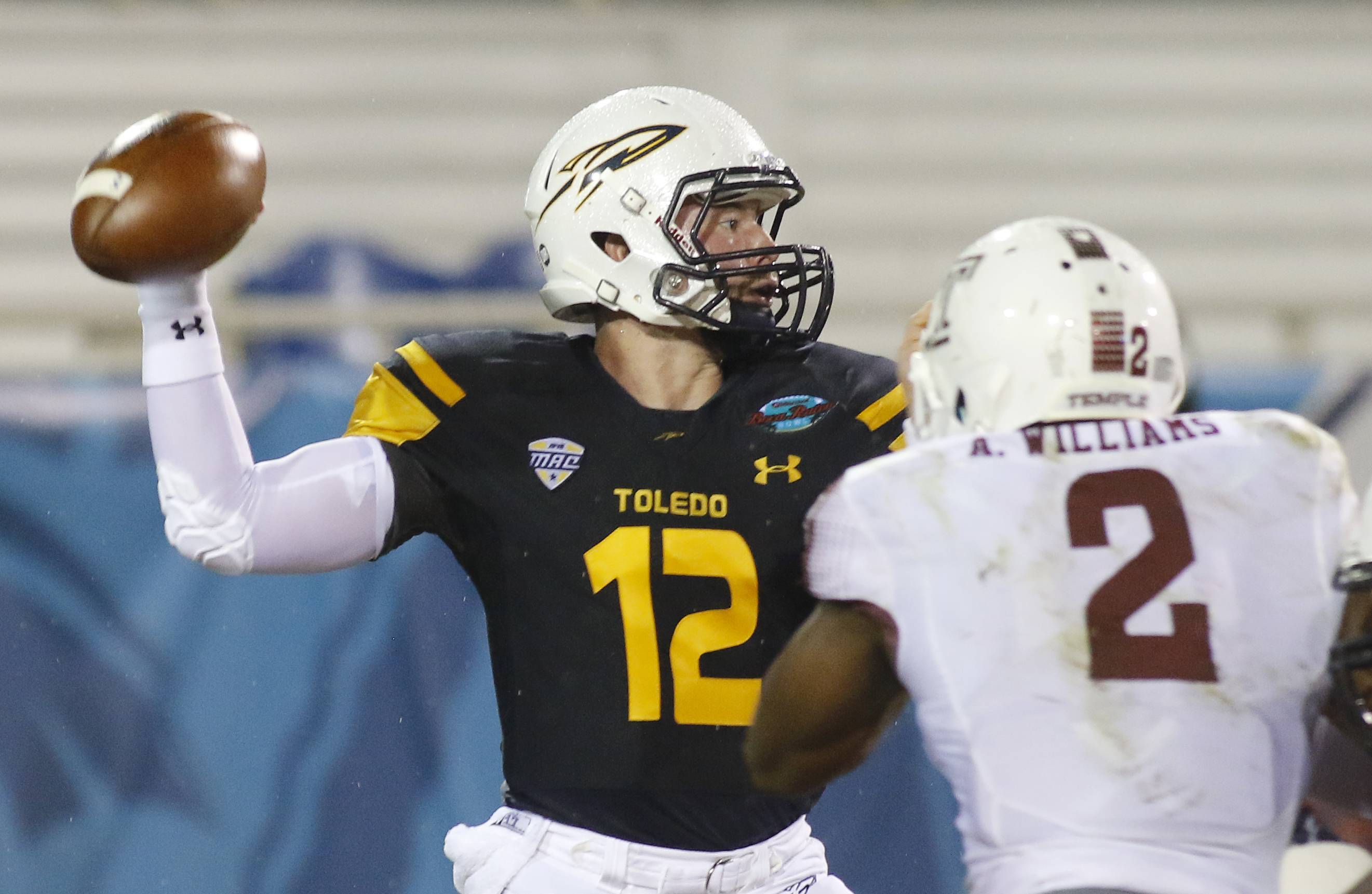 Toledo quarterback Phillip Ely (12) throws under pressure from Temple linebacker Avery Williams (2) in the first quarter of the Boca Raton Bowl NCAA college football game Tuesday, Dec. 22, 2015, in Boca Raton, Fla. (AP Photo/Joe Skipper)