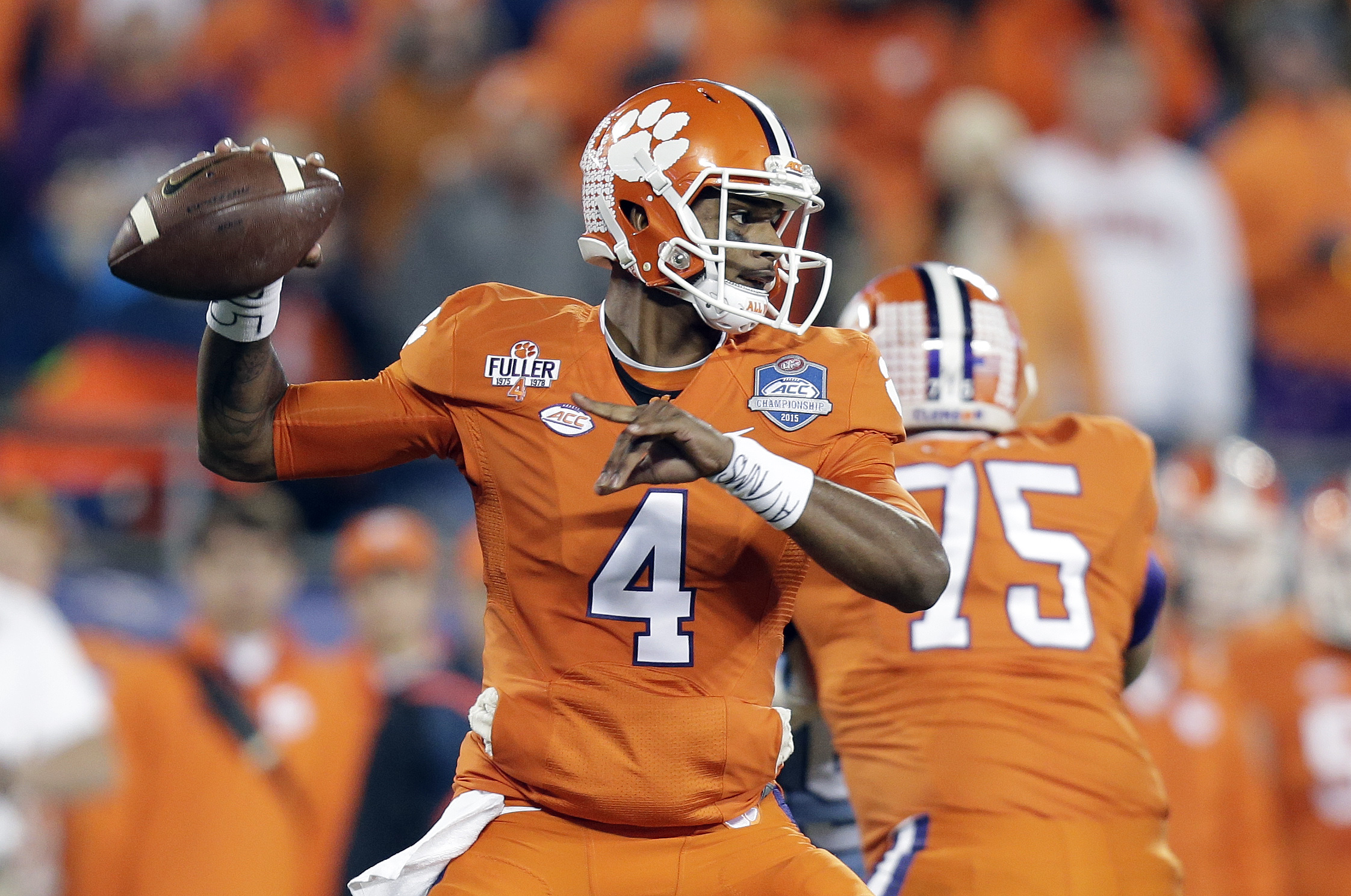 FILE - In this Dec. 5, 2015 file photo, Clemson quarterback Deshaun Watson looks to pass against North Carolina during the first half of the Atlantic Coast Conference championship NCAA college football game in Charlotte, N.C. Watson is the face of No. 1 C