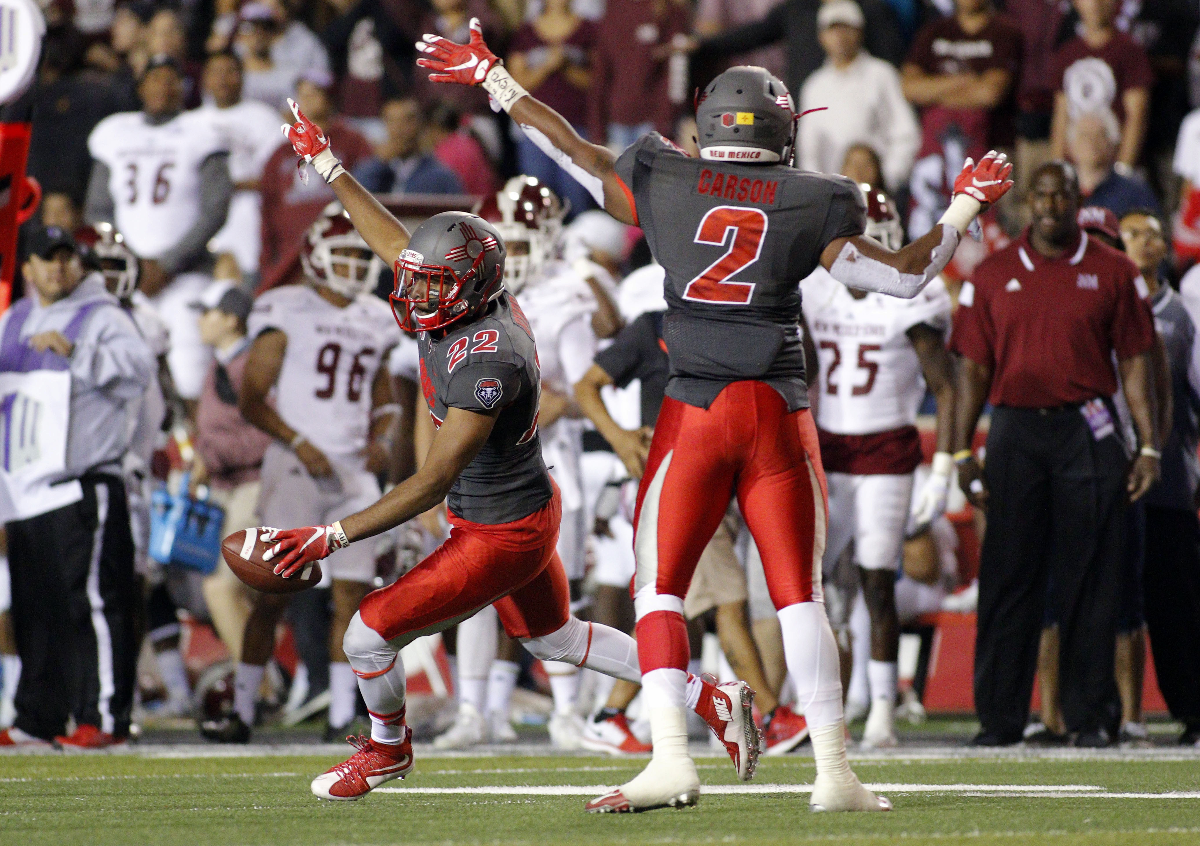 New Mexico safety Markel Byrd (22) celebrates with linebacker Kimmie Carson (2) after an interception during the second half of an NCAA college football game in Albuquerque, N.M., Saturday, Oct. 3, 2015. New Mexico won 38-29. (AP Photo/Andres Leighton)