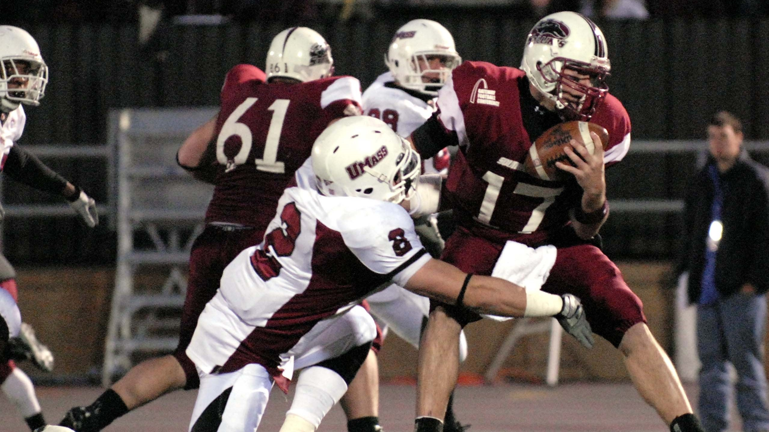 Southern Illinois quarterback Nick Hill, right, is brought down in the backfield by Massachusetts' Jeremy Horne during a college football playoff game, Saturday, Dec. 1, 2007 in Carbondale, Ill. (AP Photo/Pamela Kay Schmalenberger)