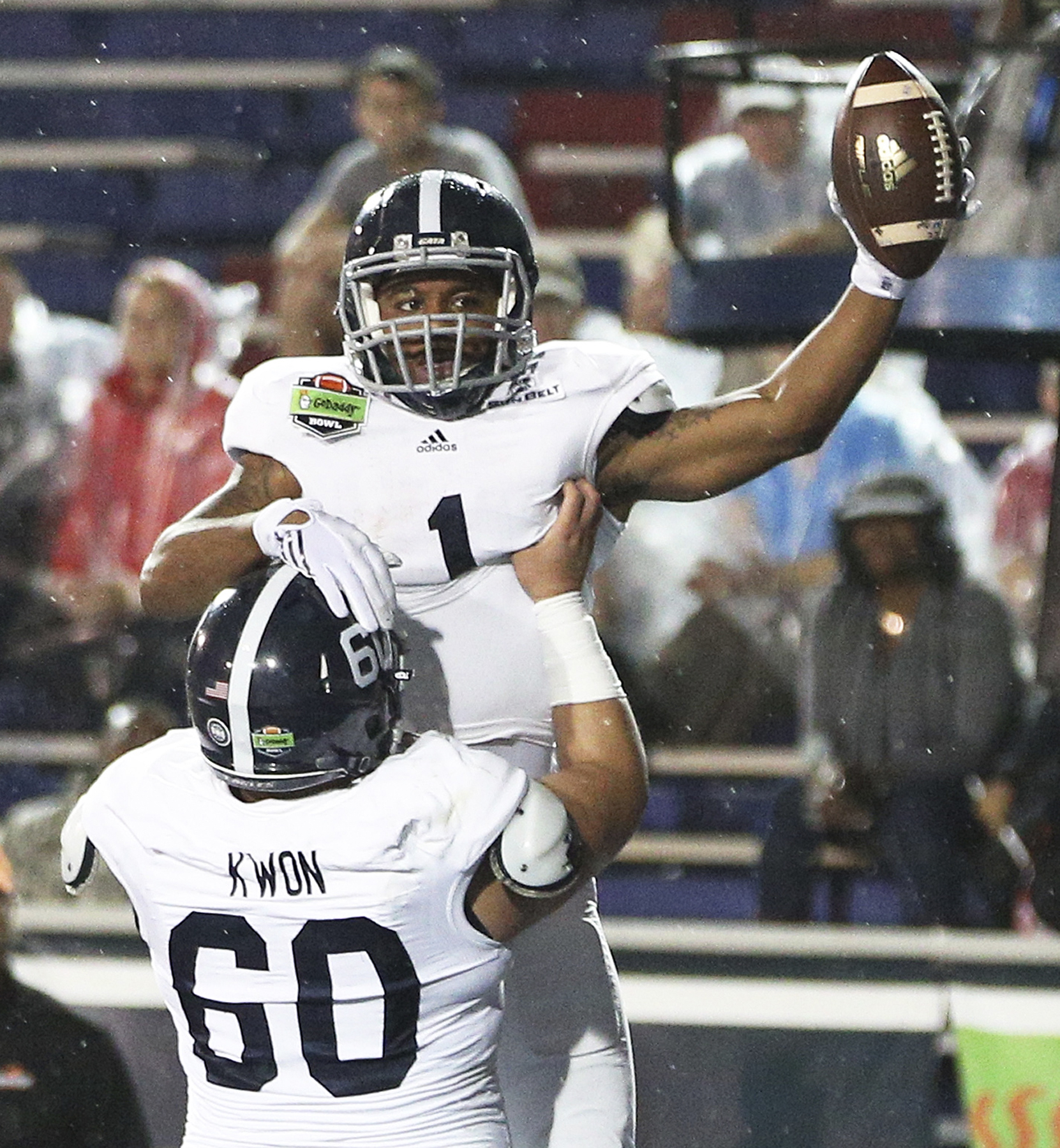 Georgia Southern offensive lineman Andy Kwon (60) celebrates with running back L.A. Ramsby (1) after Ramsby's touchdown against Bowling Green during the first half of the GoDaddy Bowl NCAA college football game Wednesday, Dec. 23, 2015, in Mobile, Ala. (M