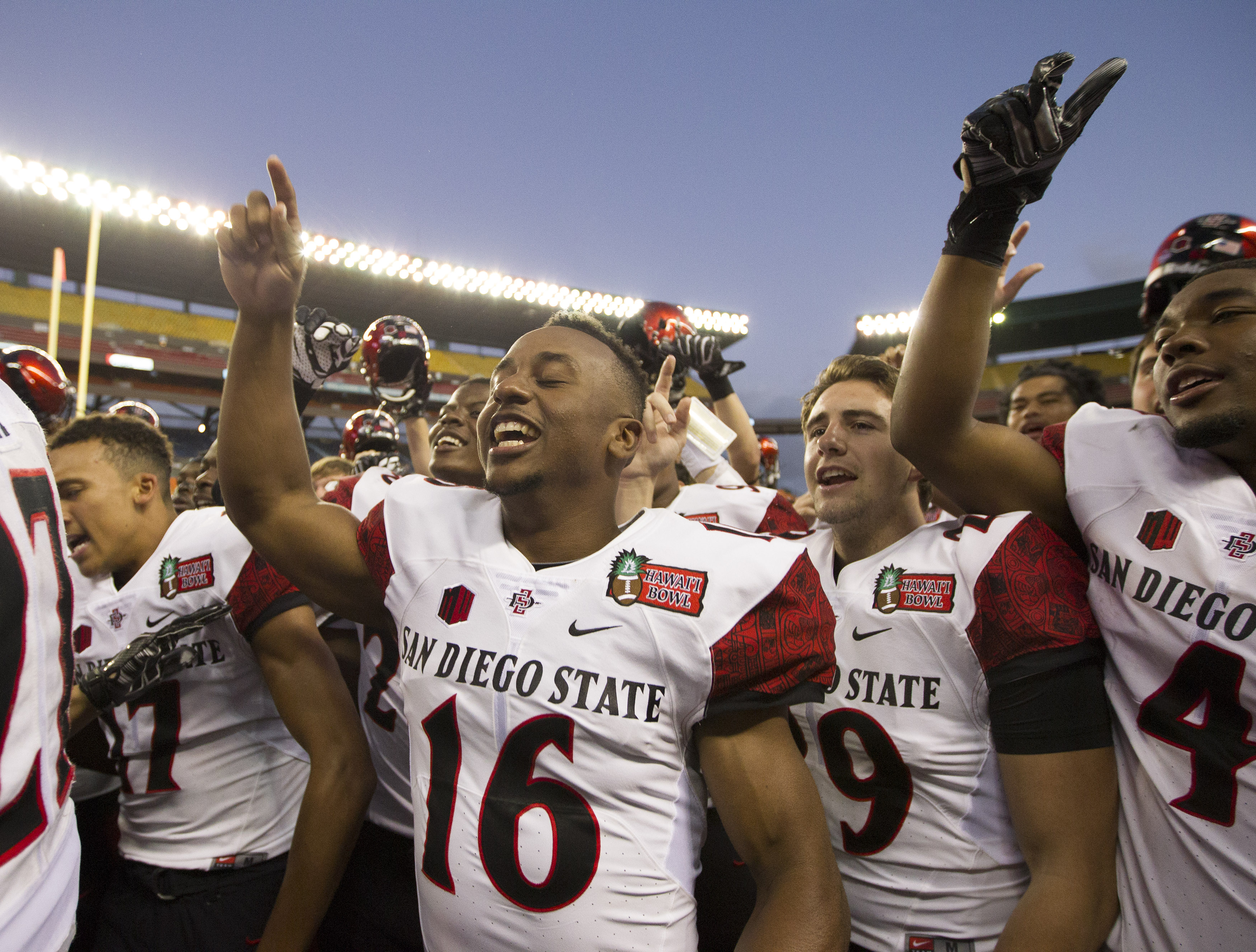 San Diego State defensive back Dwayne Parchment (16) along with his teammates sing their school song after winning the Hawaii Bowl NCAA college football game over Cincinnati, Thursday, Dec. 24, 2015, in Honolulu. San Diego State won 42-7. (AP Photo/Eugene