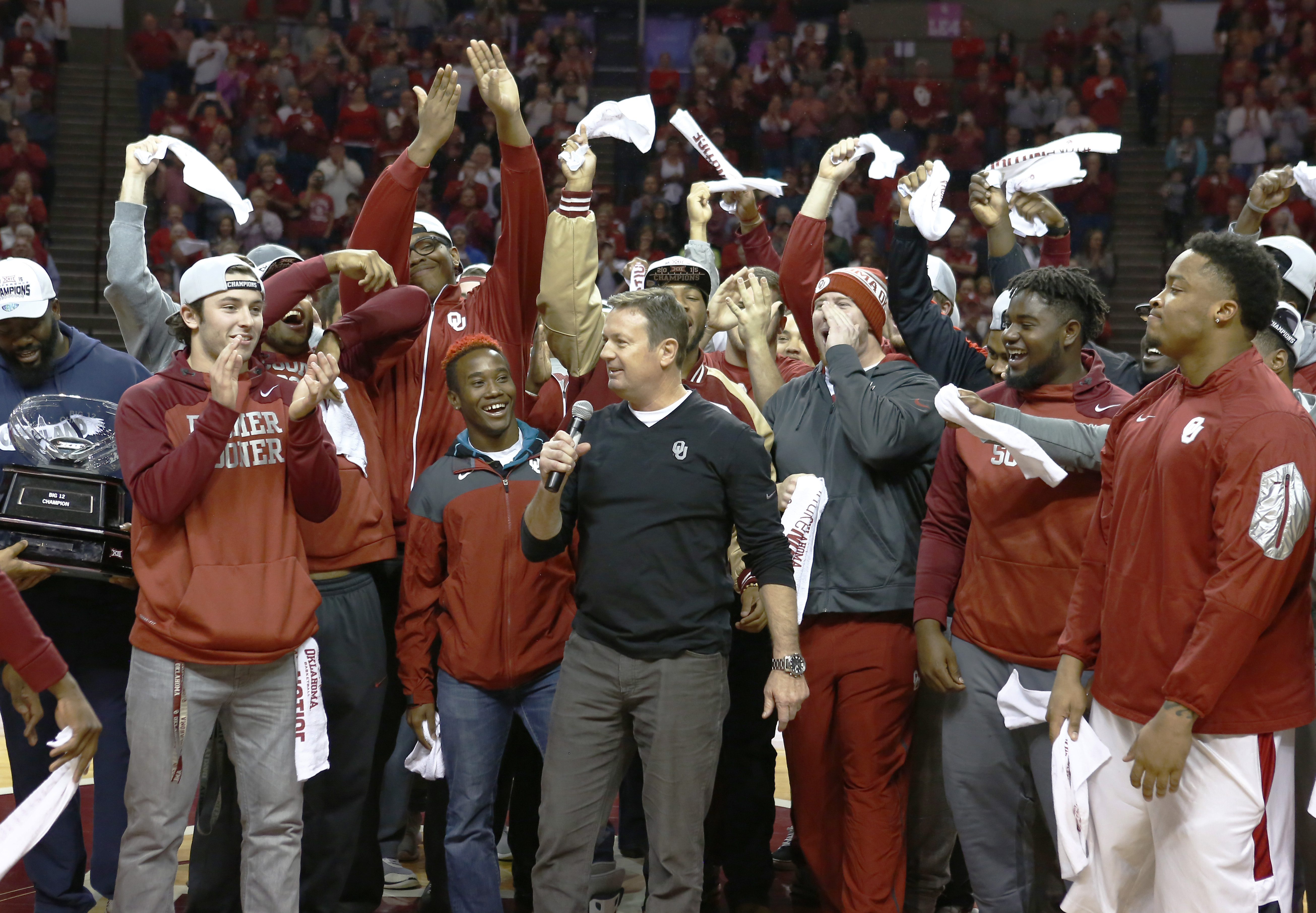 FILE - In this Sunday, Nov. 29, 2015, file photo, Oklahoma football head coach Bob Stoops, center, thanks the crowd for support during the halftime of an NCAA college basketball game against Wisconsin in Norman, Okla. The Sooners wisely stuck with Stoops