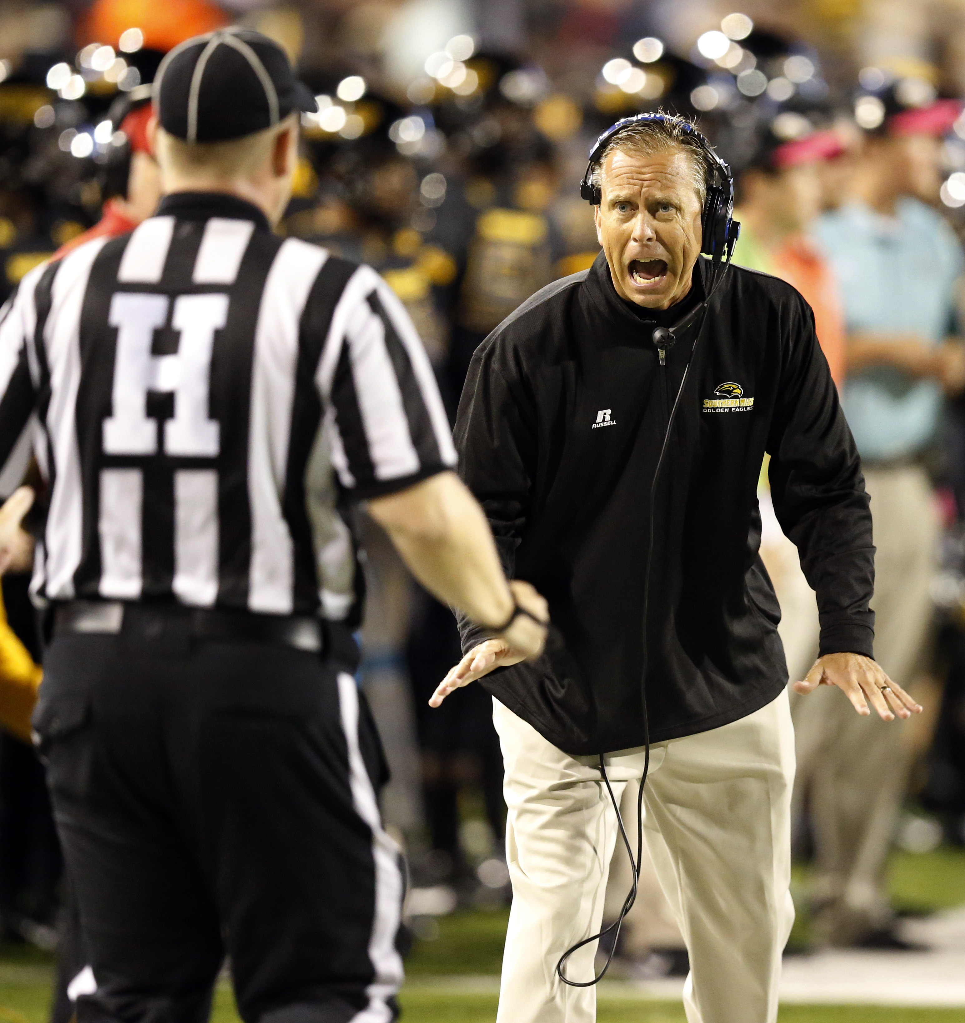 FILE - In this Saturday, Oct. 3, 2015, file photo, Southern Mississippi football coach Todd Monken complains about a call to an official in the second half of an NCAA college football game against North Texas in Hattiesburg, Miss. Southern Mississippi has