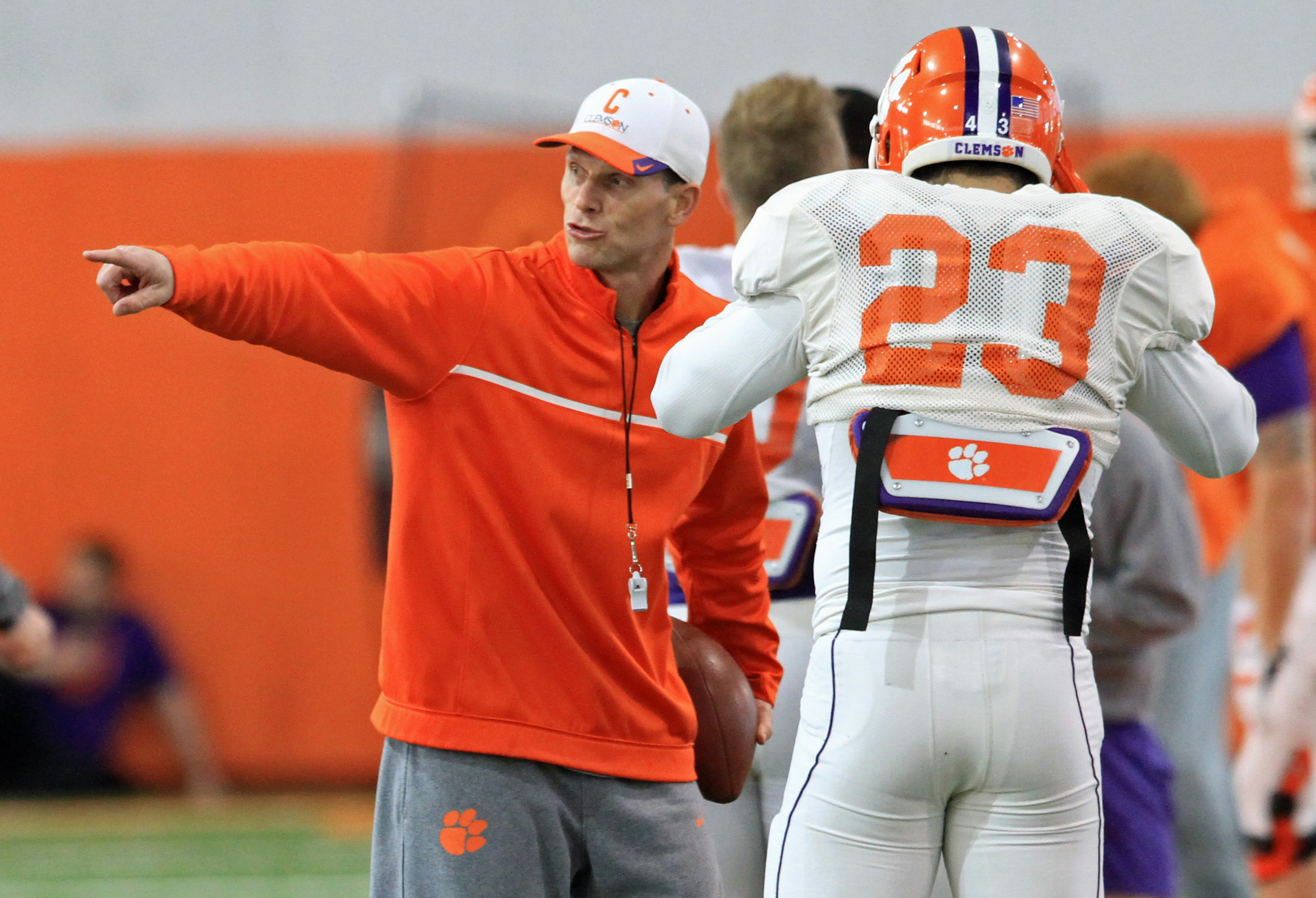 FILE - In this Saturday, Dec. 13, 2014, file photo, Clemson defensive coordinator Brent Venables, left, gives instructions during an NCAA college football bowl practice session, in Clemson, S.C. Former Oklahoma assistant Venables leads No. 1 Clemson's def