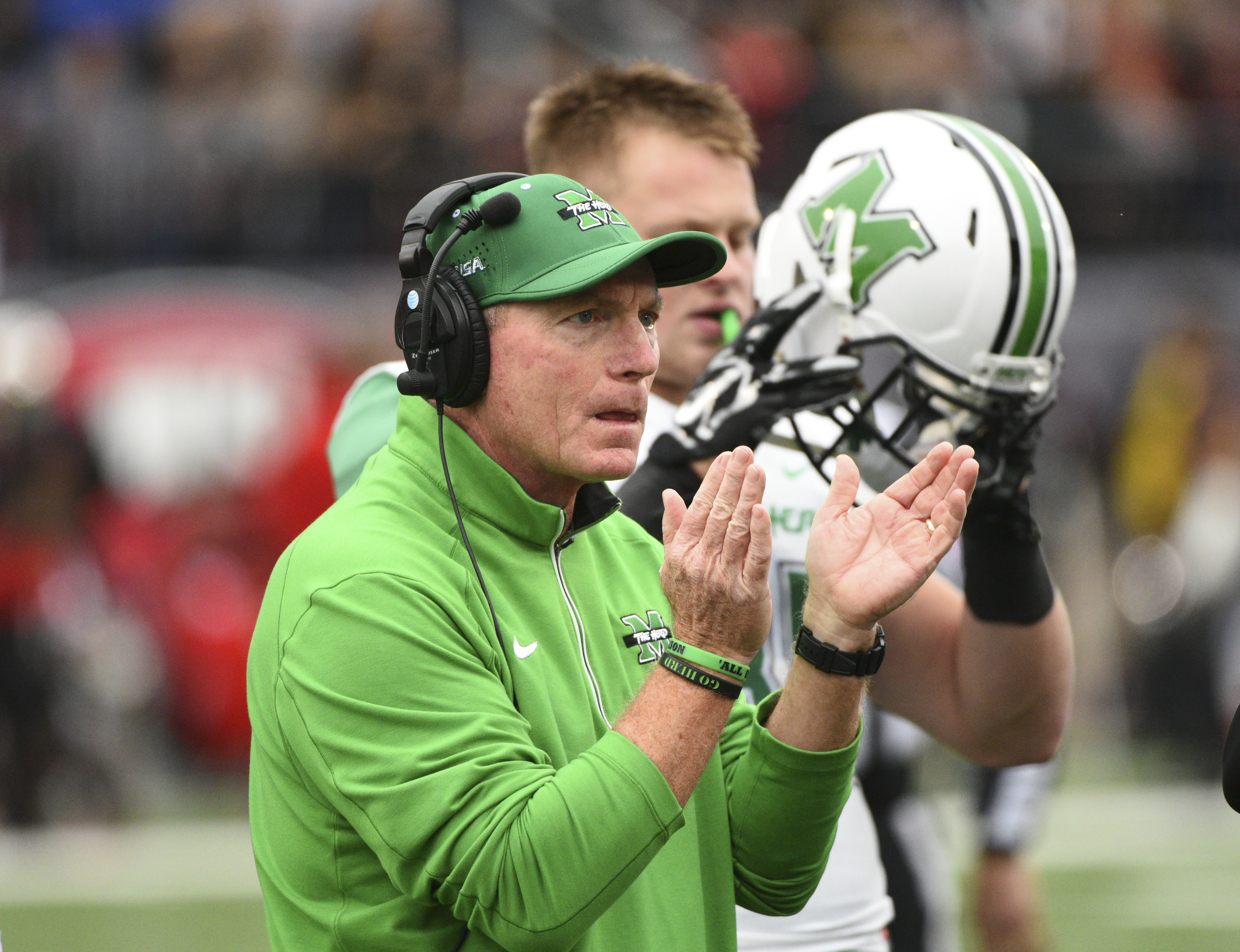 FILE - In this Friday, Nov. 27, 2015, file photo, Marshall's Doc Holiday claps for his players during the first half of an NCAA college football game against Western Kentucky, in Bowling Green, Ky. Marshall has a shot at another 10-victory season and Conn