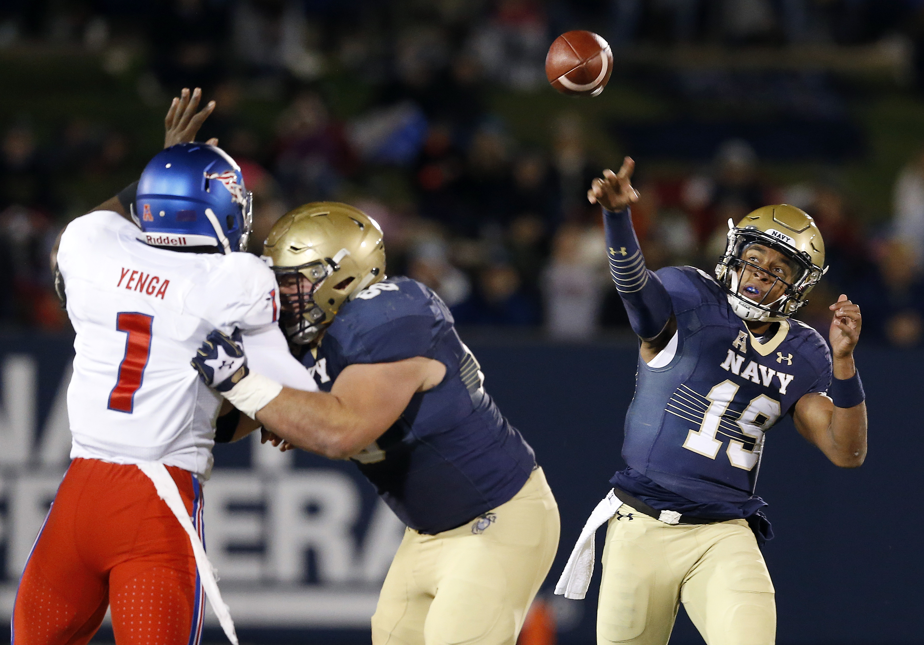 FILE - In this Saturday, Nov. 14, 2015, file photo, Navy quarterback Keenan Reynolds (19) throws to a receiver as guard Ben Tamburello, center, blocks SMU linebacker Jonathan Yenga in the second half of an NCAA college football game, in Annapolis, Md. Nav