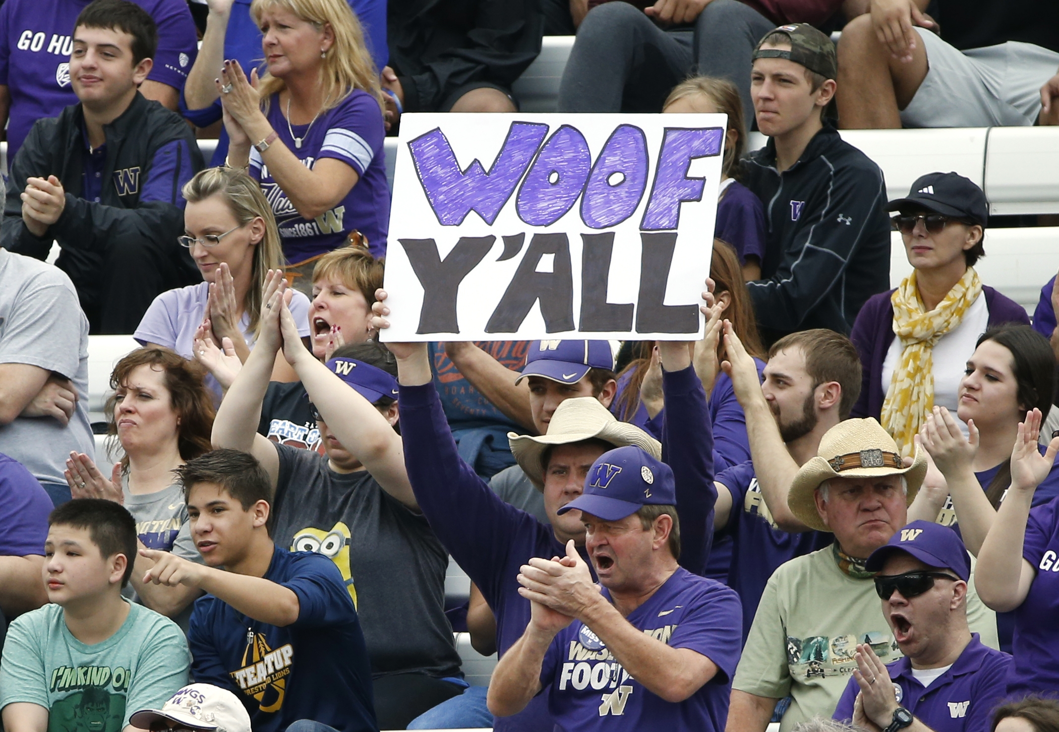 Washington fans cheer for their team against Southern Mississippi during the first half of the Heart of Dallas Bowl NCAA college football game, Saturday, Dec. 26, 2015, in Dallas. (AP Photo/Ron Jenkins)