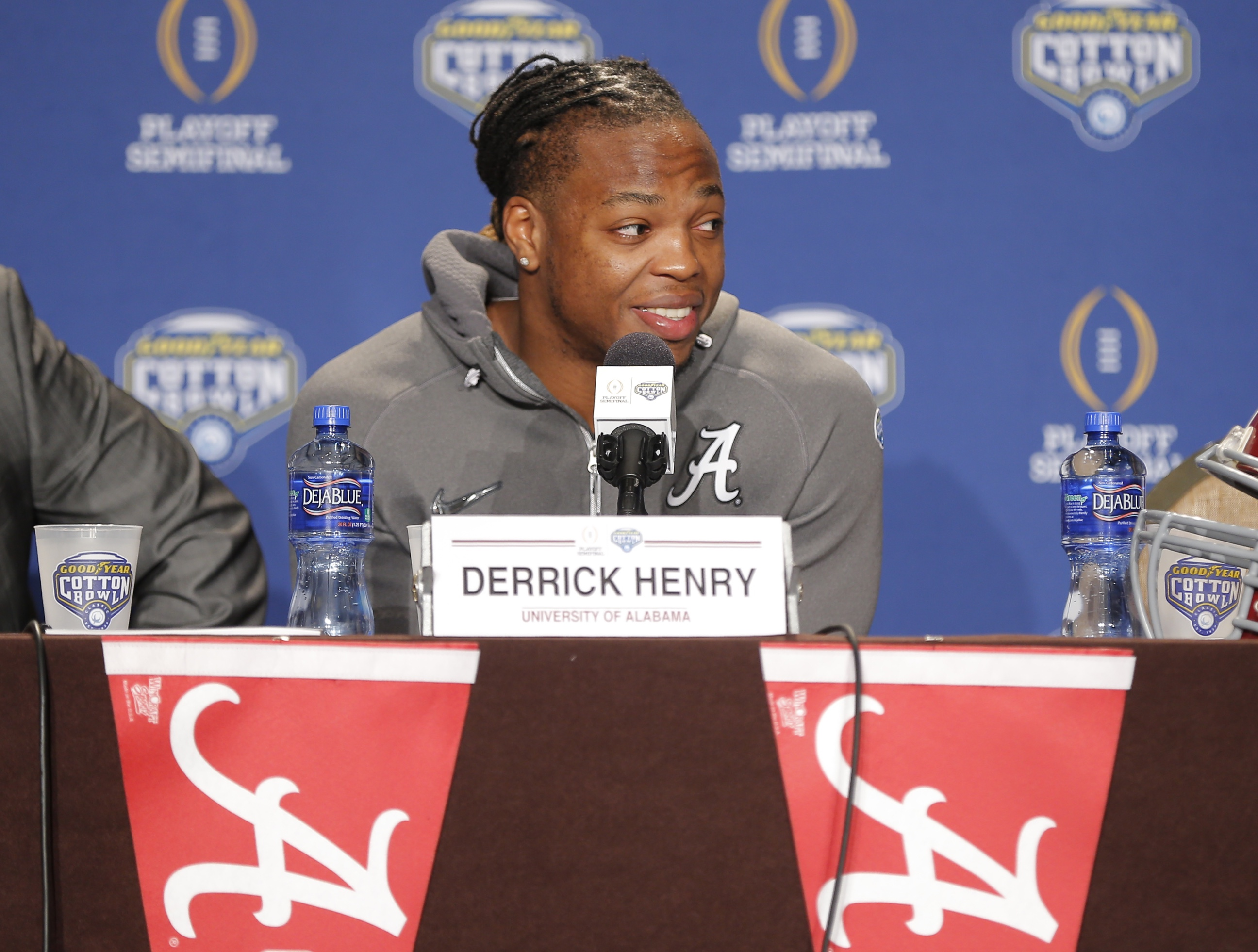 Alabma running back Derrick Henry answers questions during a news conference for the NCAA Cotton Bowl college football game against Michigan State, Sunday, Dec. 27, 2015, in Dallas. (AP Photo/Brandon Wade)