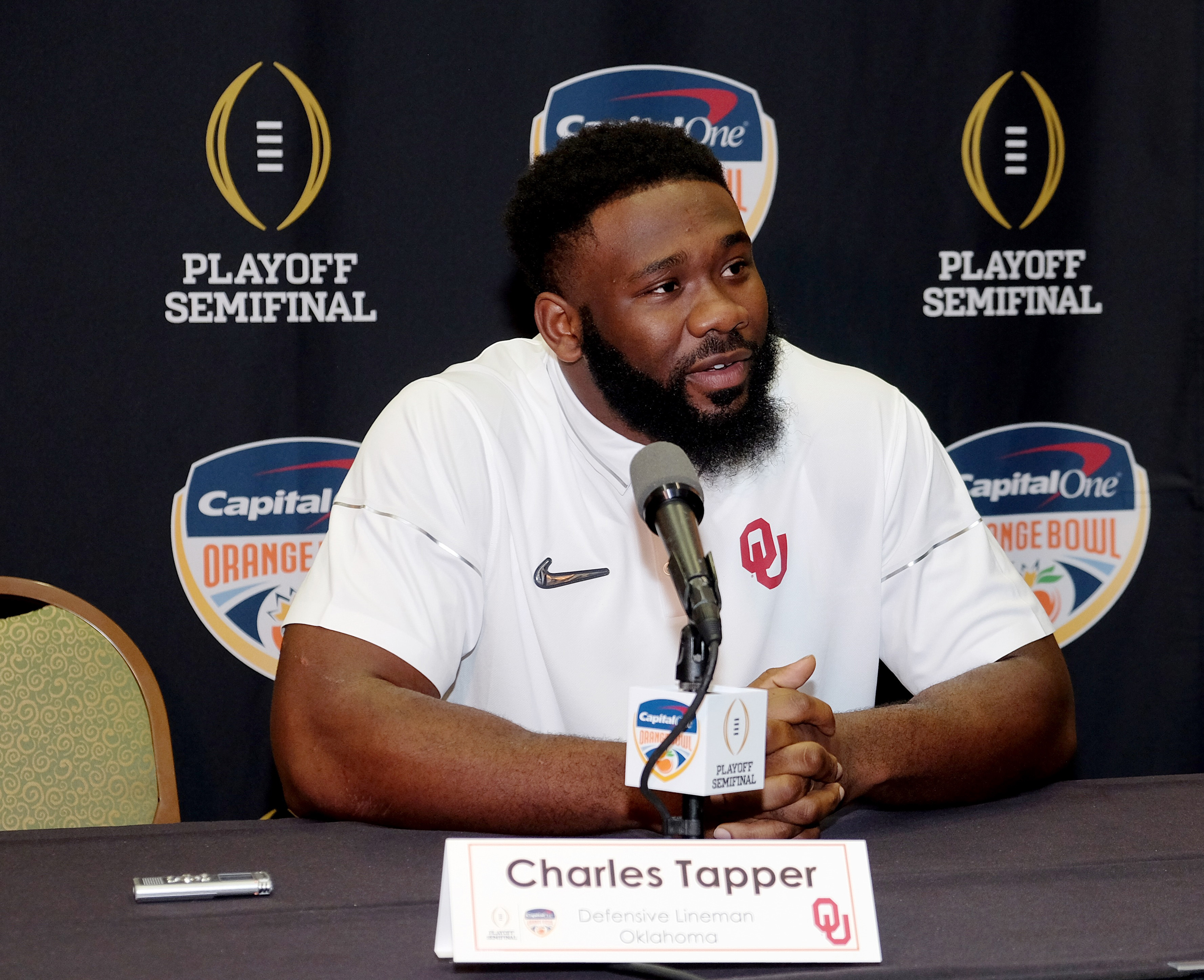 Oklahoma defensive lineman Charles Tapper speaks to the media at a press conference in Fort Lauderdale, Fla., Sunday, Dec. 27, 2015. Oklahoma will play Clemson in the Orange Bowl on New Year's Eve. (AP Photo/Gaston De Cardenas)