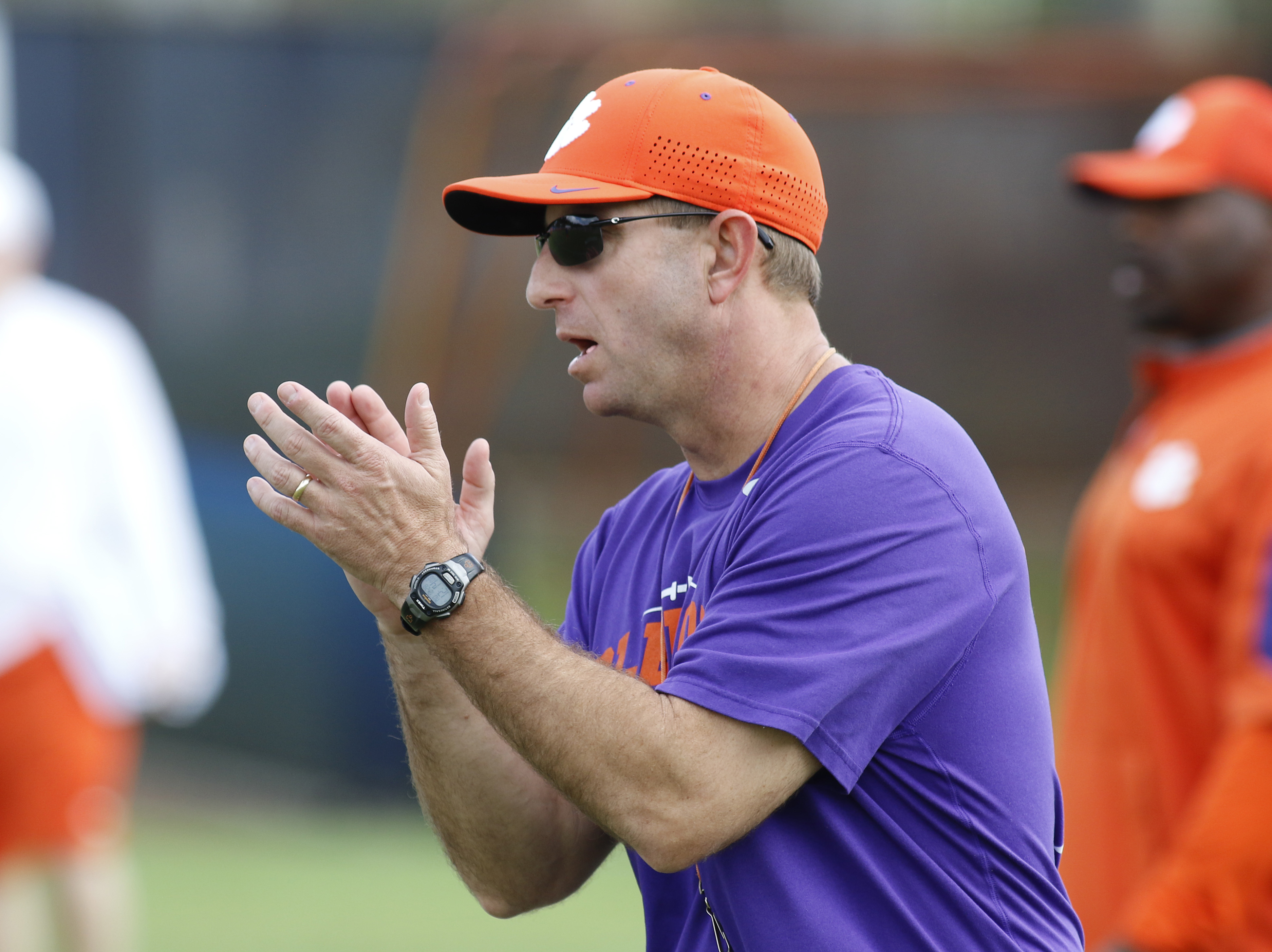 Clemson head coach Dabo Swinney reacts during NCAA college football practice Monday, Dec. 28, 2015, in Davie, Fla. Clemson is scheduled to play Oklahoma in the Orange Bowl on New Year's Eve. (AP Photo/Joe Skipper)
